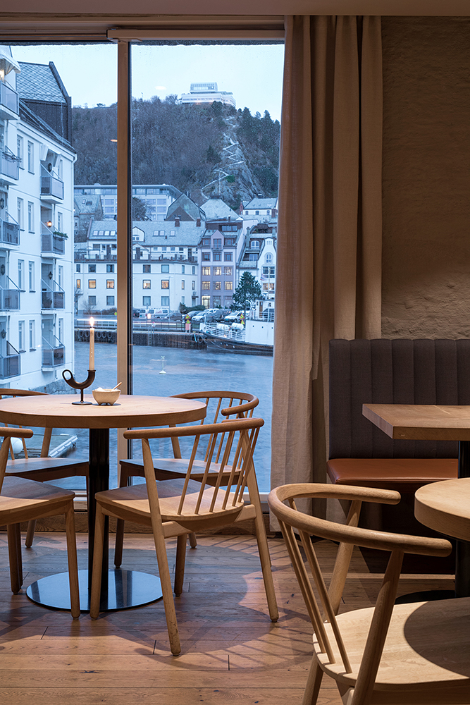 Hotel Brosundet Ålesund Norway, modern design dining area with Scandinavian wood furniture, by GARDE. Mads Emil Garde
