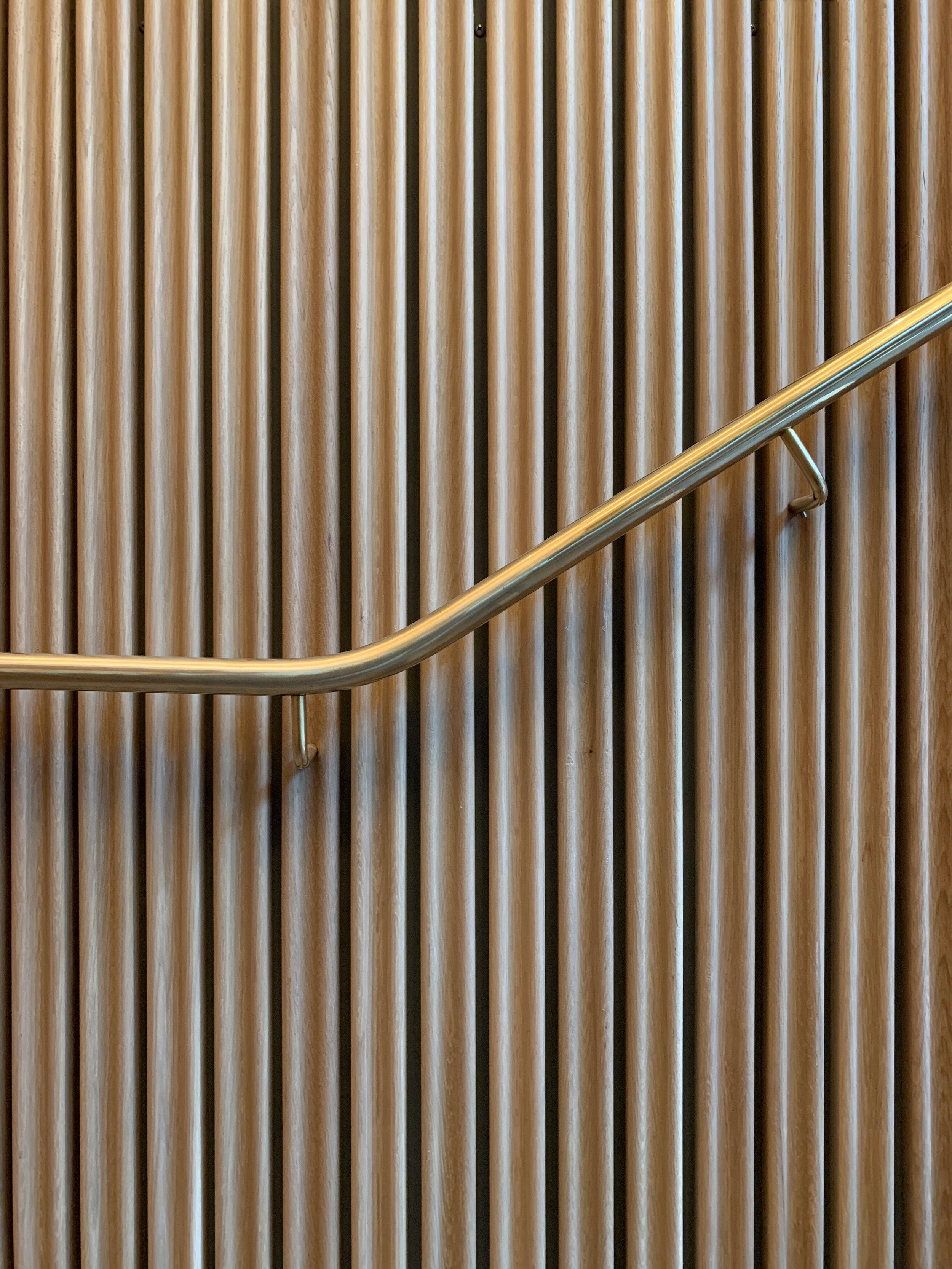Restaurant Tivander architect drawn staircase, brass hand railing