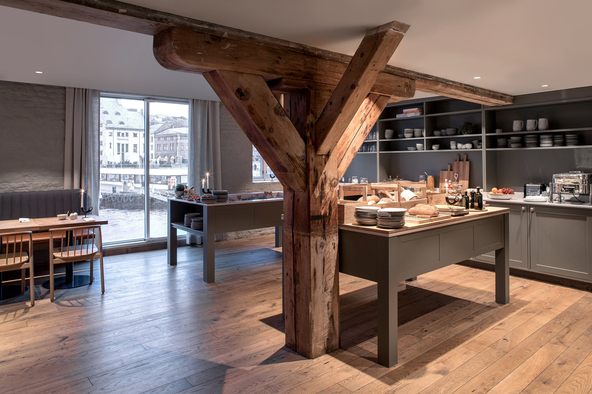 Hotel Brosundet Ålesund Norway, modern design dining area in raw wood and gray, by GARDE. Mads Emil Garde