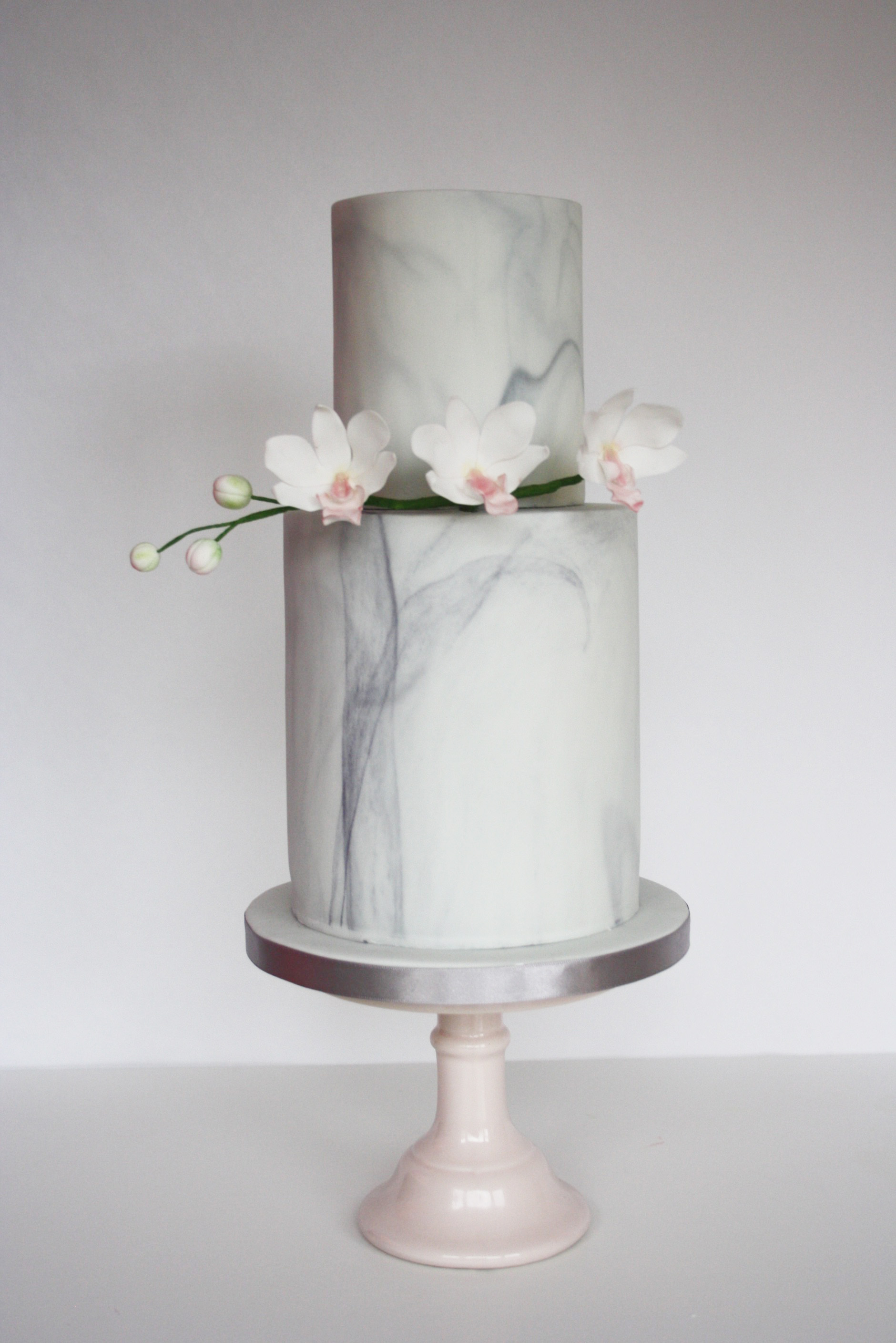 Malarkey Cakes Marble pillar wedding cake with orchids.jpg