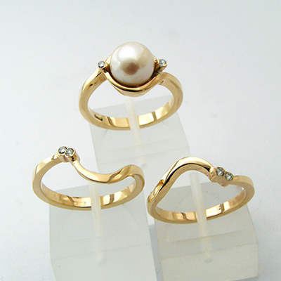 Pearl Engagment ring with matching wedding and eternity bands