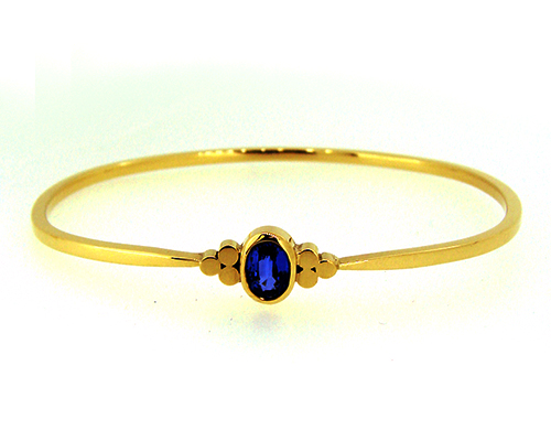 Ceylon Blue Sapphire 18ct Yellow Gold Bangle Triskle Design.jpg