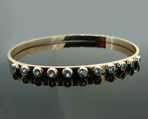 Rose Gold, White Gold and Blue Topaz Bangle.jpg