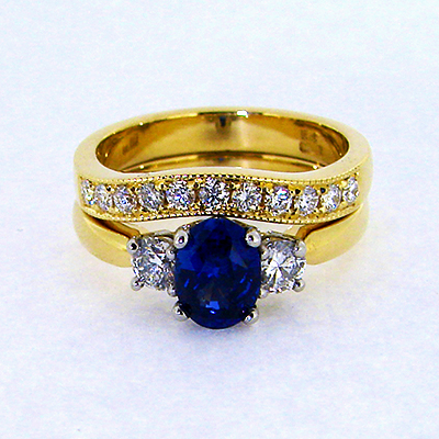 Saphire and diamond engagement ring with fitted wedding band.jpg