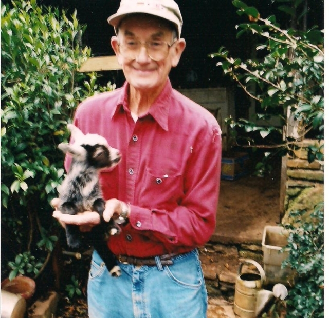 Mr. Ora Coleman with one of his baby goats