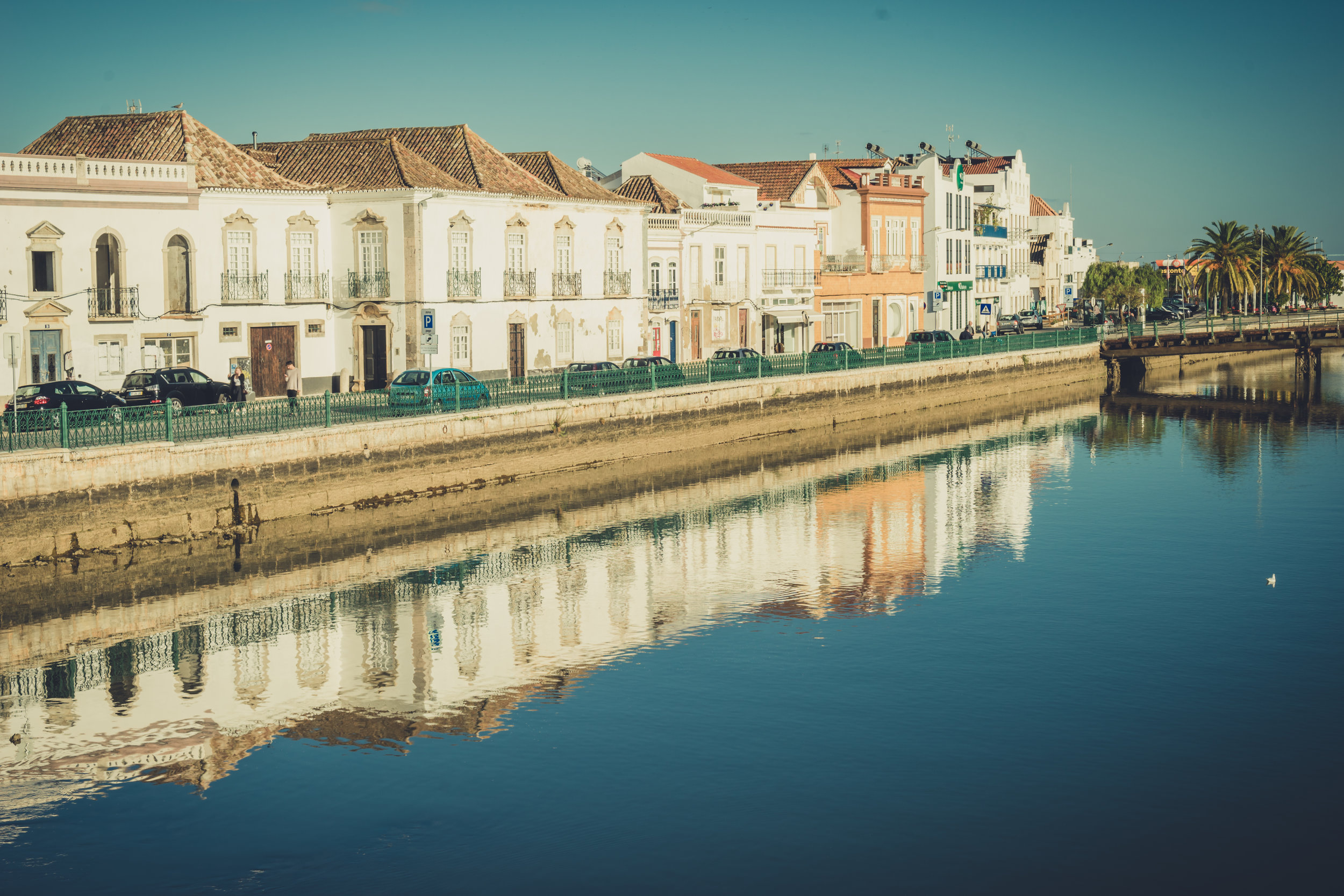 Tavira Roman Bridge. Old town Tavira. Street scene in Tavira. Algarve. River reflections.JPG