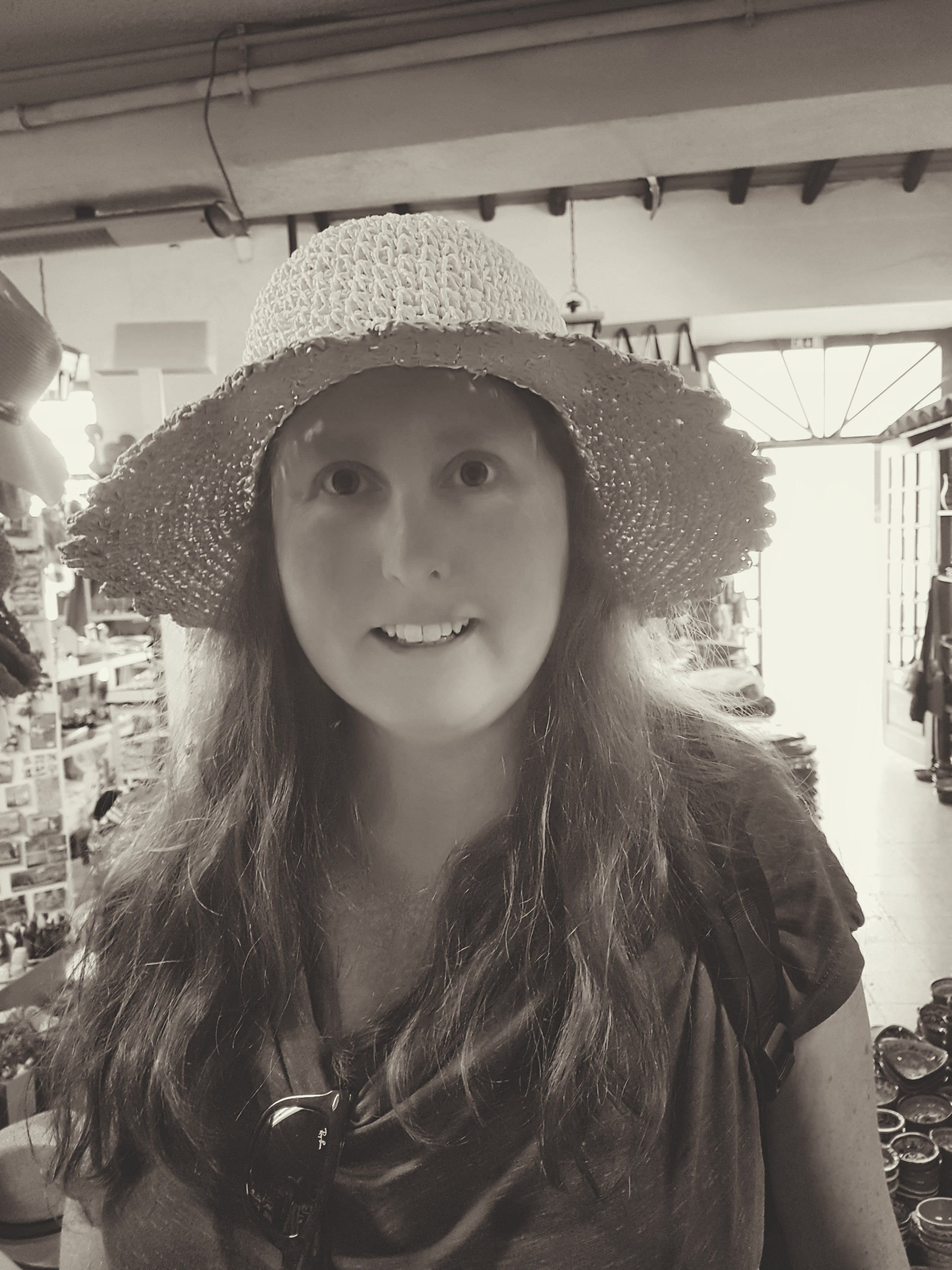trying on a hat in Loule. Loule in the Algarve. Old town loule..jpg