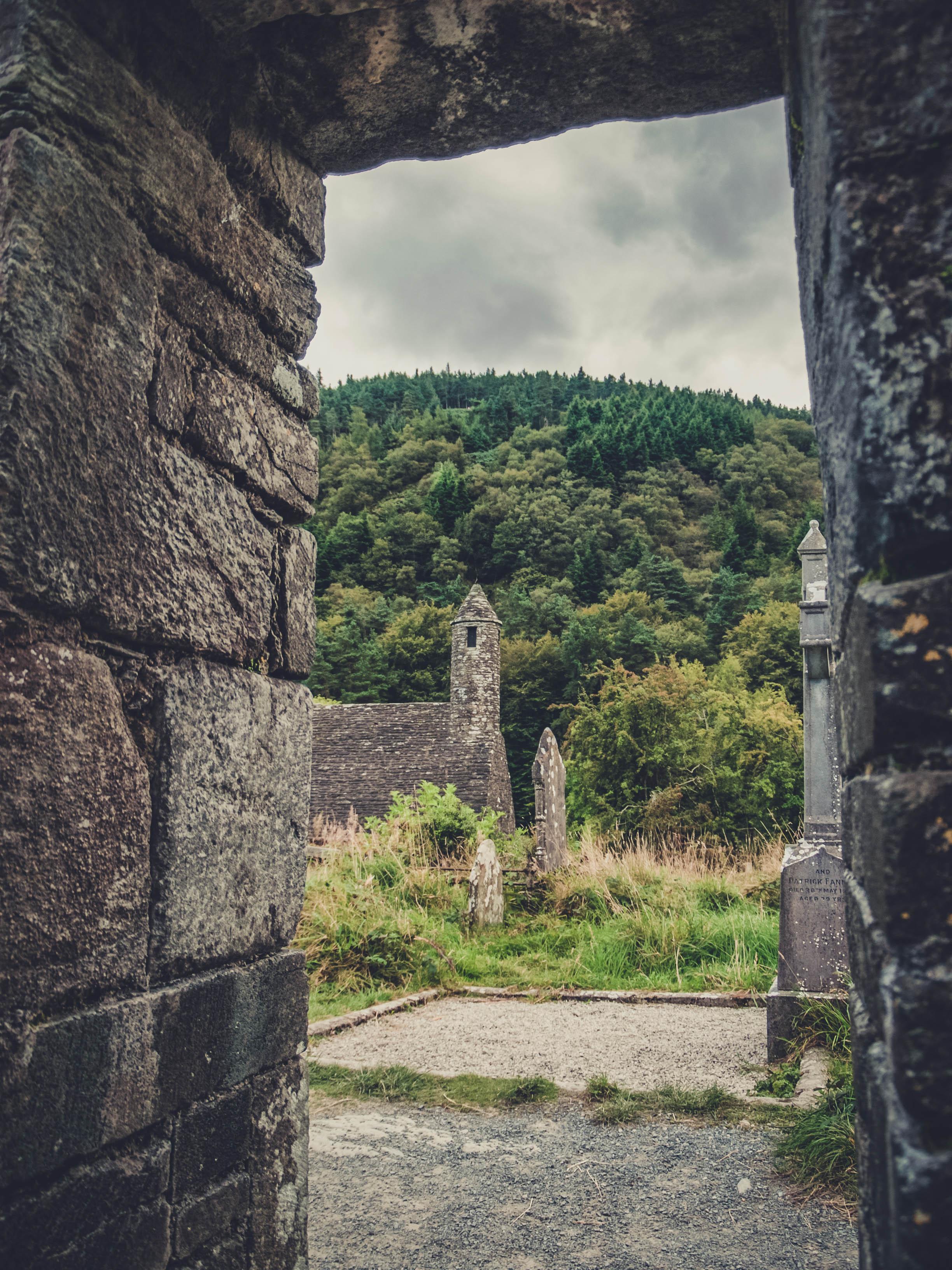 glendalough. irish history. county wicklow. round tower. hill walknig. hiking. grave yard. wildlife. tombstones. lakes. blue sky. frame.jpg