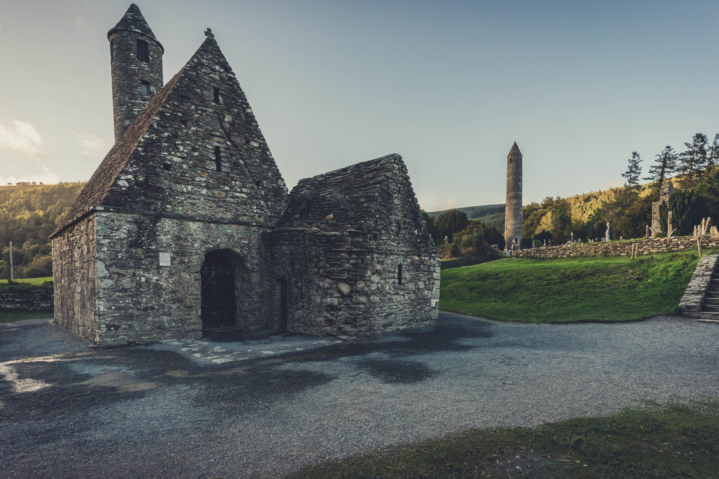 glendalough. irish history. county wicklow. round tower. hill walknig. hiking. grave yard. wildlife. tombstones. lakes. blue sky. old chirch and tower.jpg