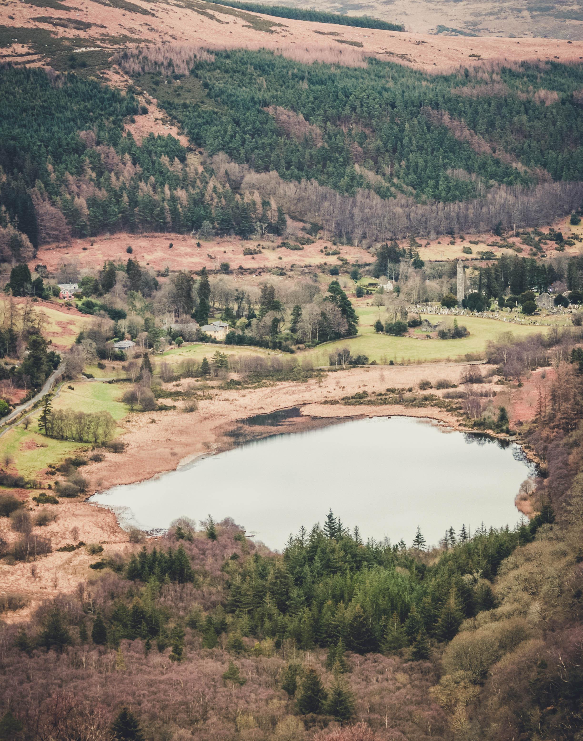 glendalough. irish history. county wicklow. round tower. hill walknig. hiking. grave yard. wildlife. tombstones. lakes. blue sky. over the lake.jpg