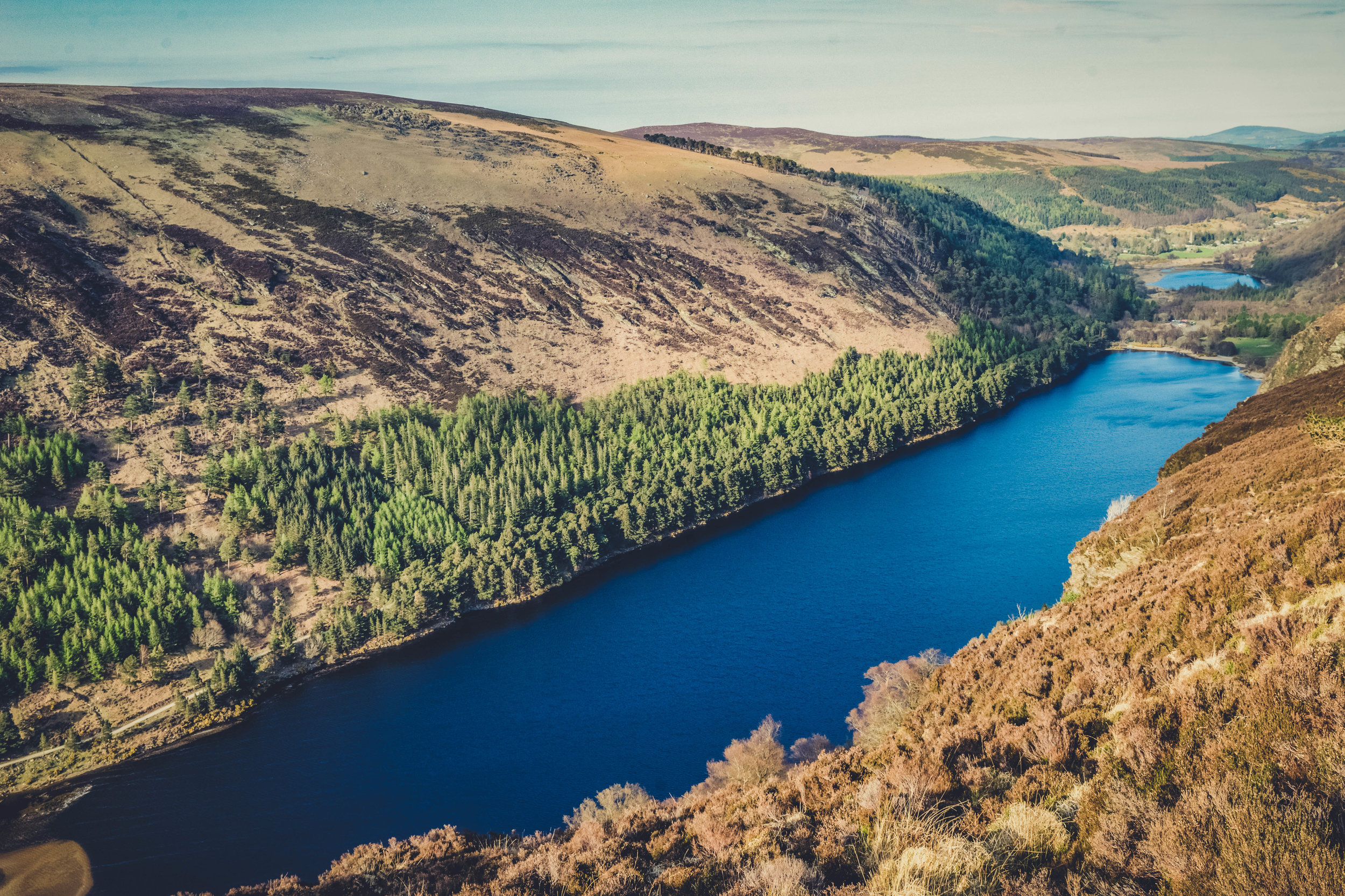 glendalough. irish history. county wicklow. round tower. hill walknig. hiking. grave yard. wildlife. tombstones. lakes. blue sky. the lower lake.jpg