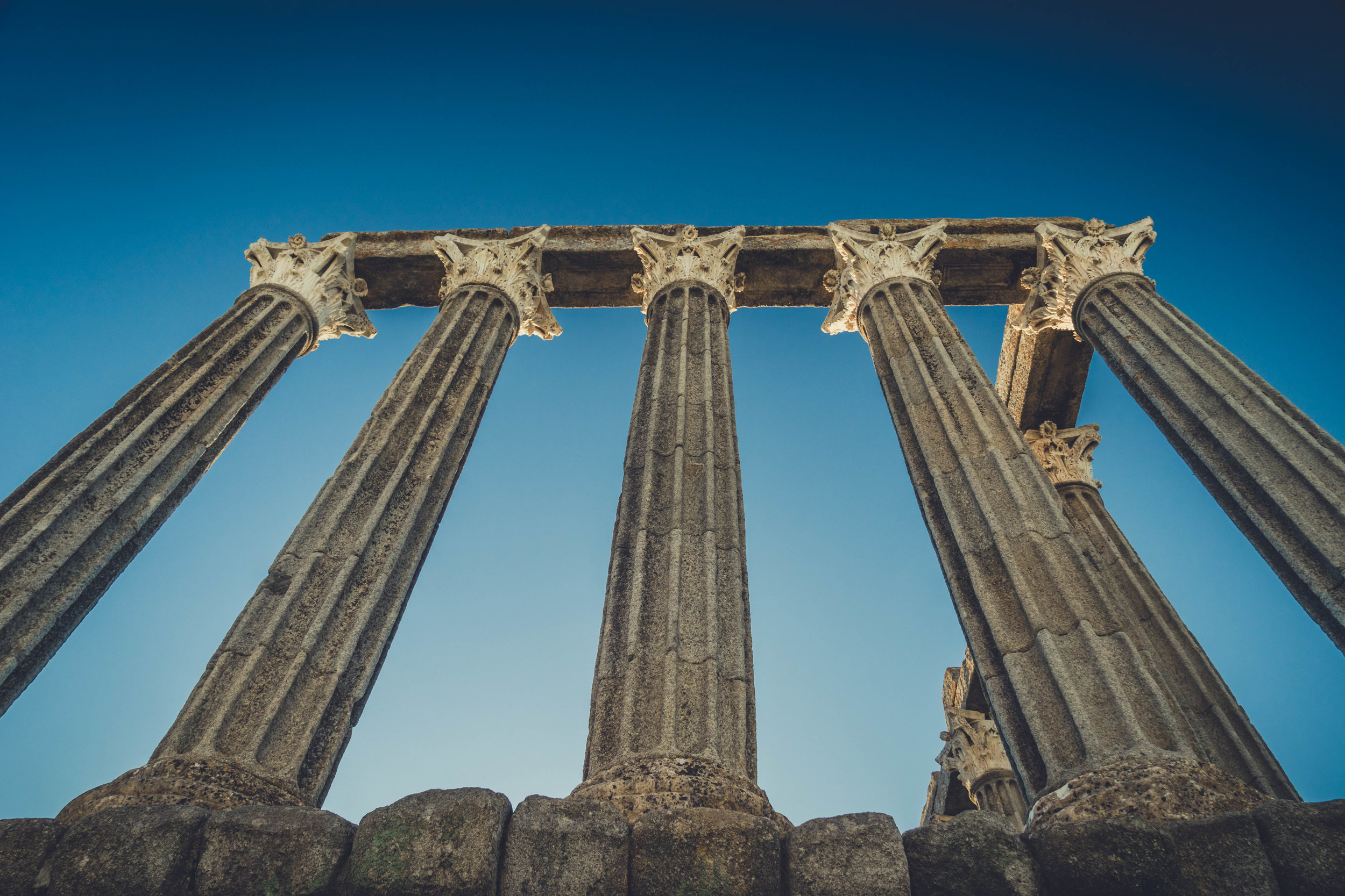 Evora. Roman Ruins. Portugal. Alentejo. Piliers. Roman city. ancient roman town. Blue sky. travel. adventure. history. historical. wine. architecture.jpg