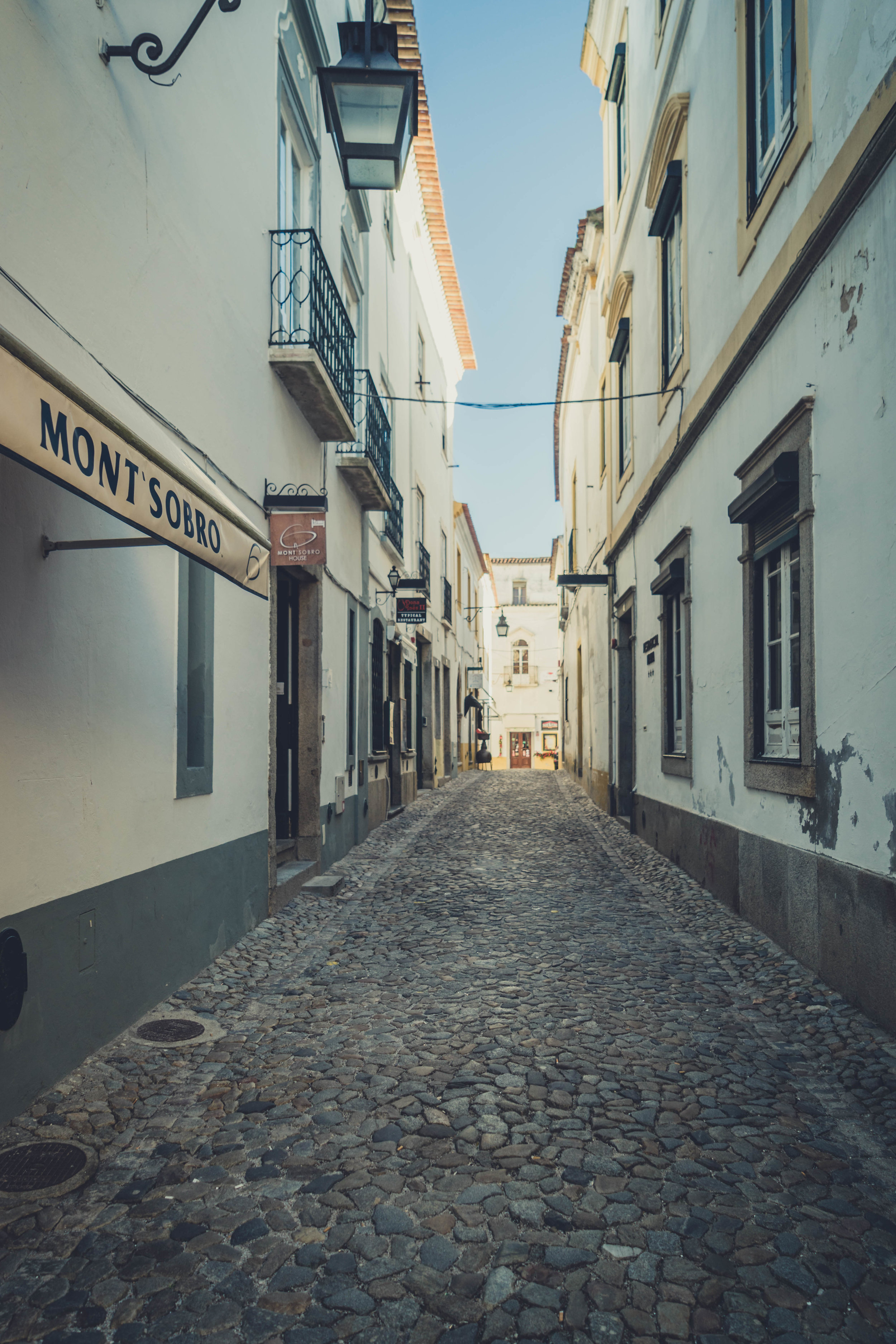 Evora. Roman Ruins. Portugal. Alentejo. Piliers. Roman city. ancient roman town. Blue sky. travel. adventure. history. historical. wine. architecture. side street.jpg