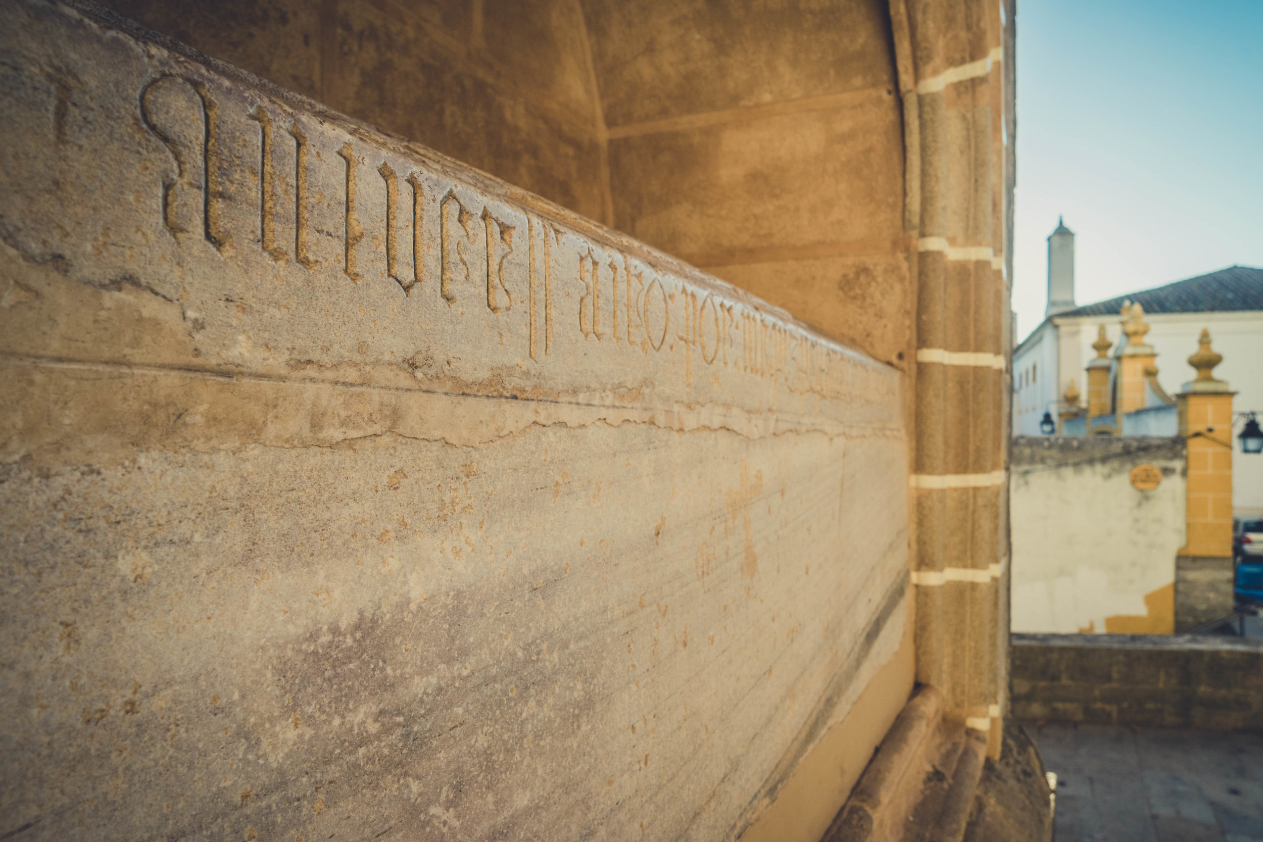 Evora. Roman Ruins. Portugal. Alentejo. Piliers. Roman city. ancient roman town. Blue sky. travel. adventure. history. historical. wine. architecture. text.jpg