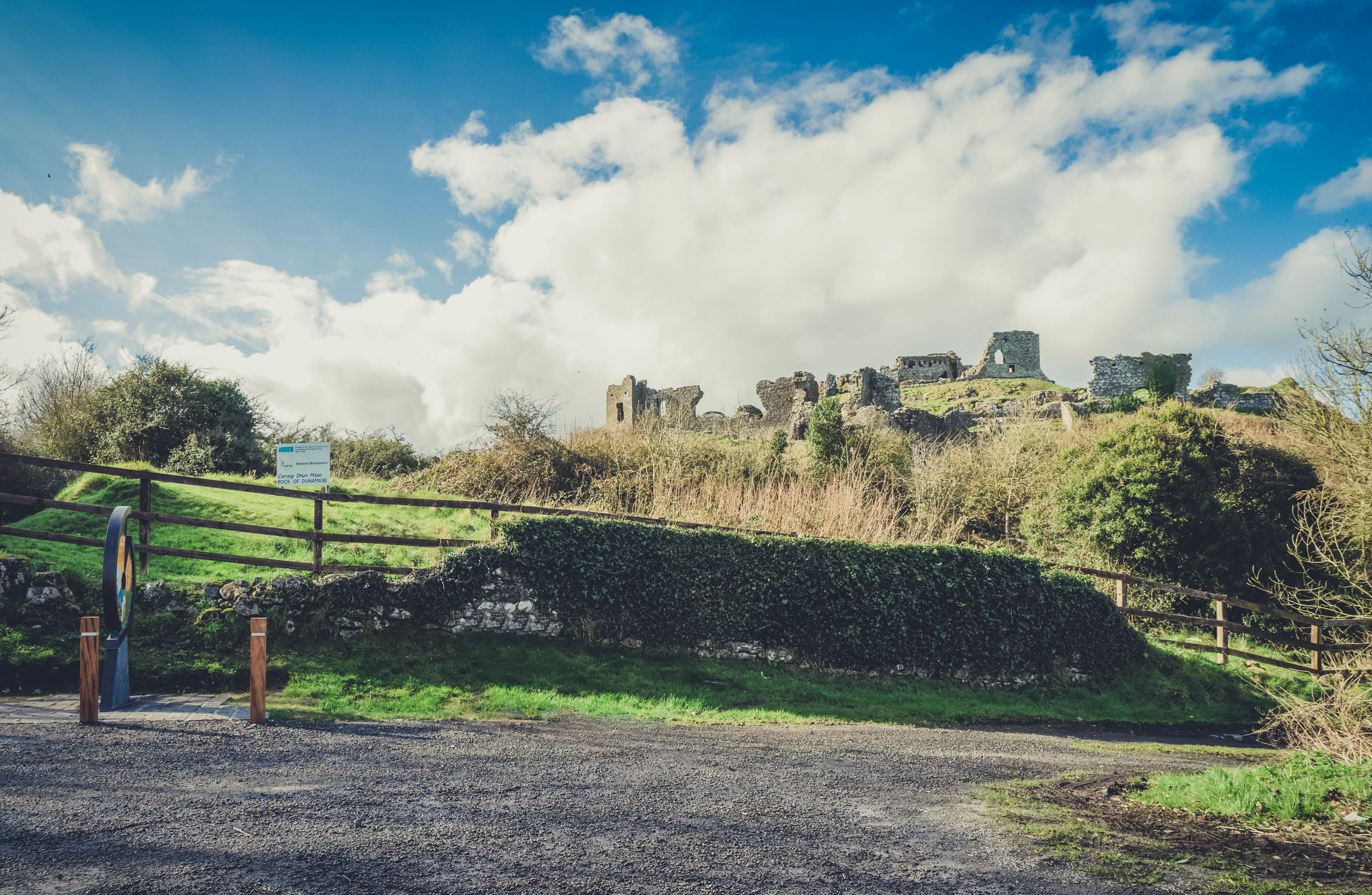 Ireland. Castle. Old castle. irish history. history. Rock of Dunamase. blue sky. rock. pathway. adventure. travel. irish counrty. green fields. castle view and path.jpg