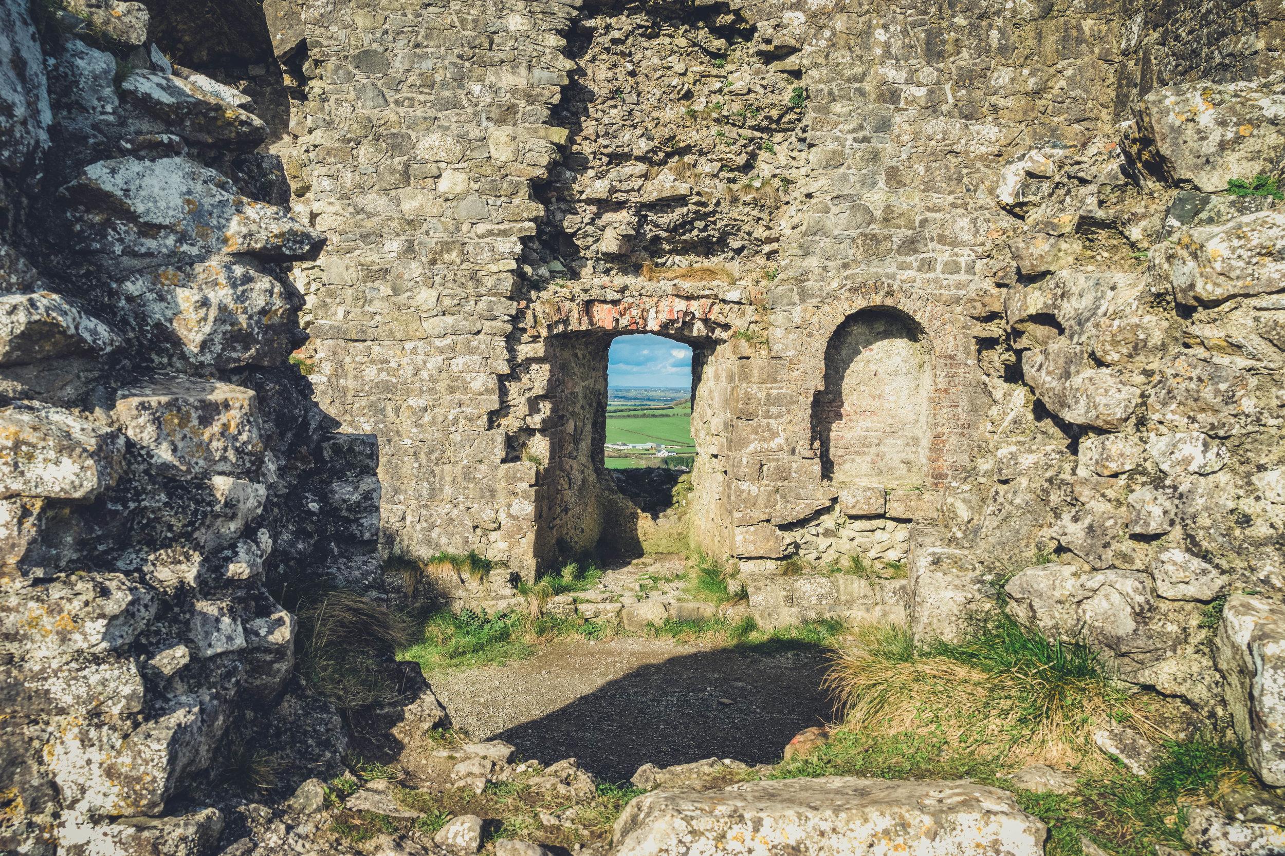 Ireland. Castle. Old castle. irish history. history. Rock of Dunamase. blue sky. rock. pathway. adventure. travel. irish counrty. castle doorway.jpg