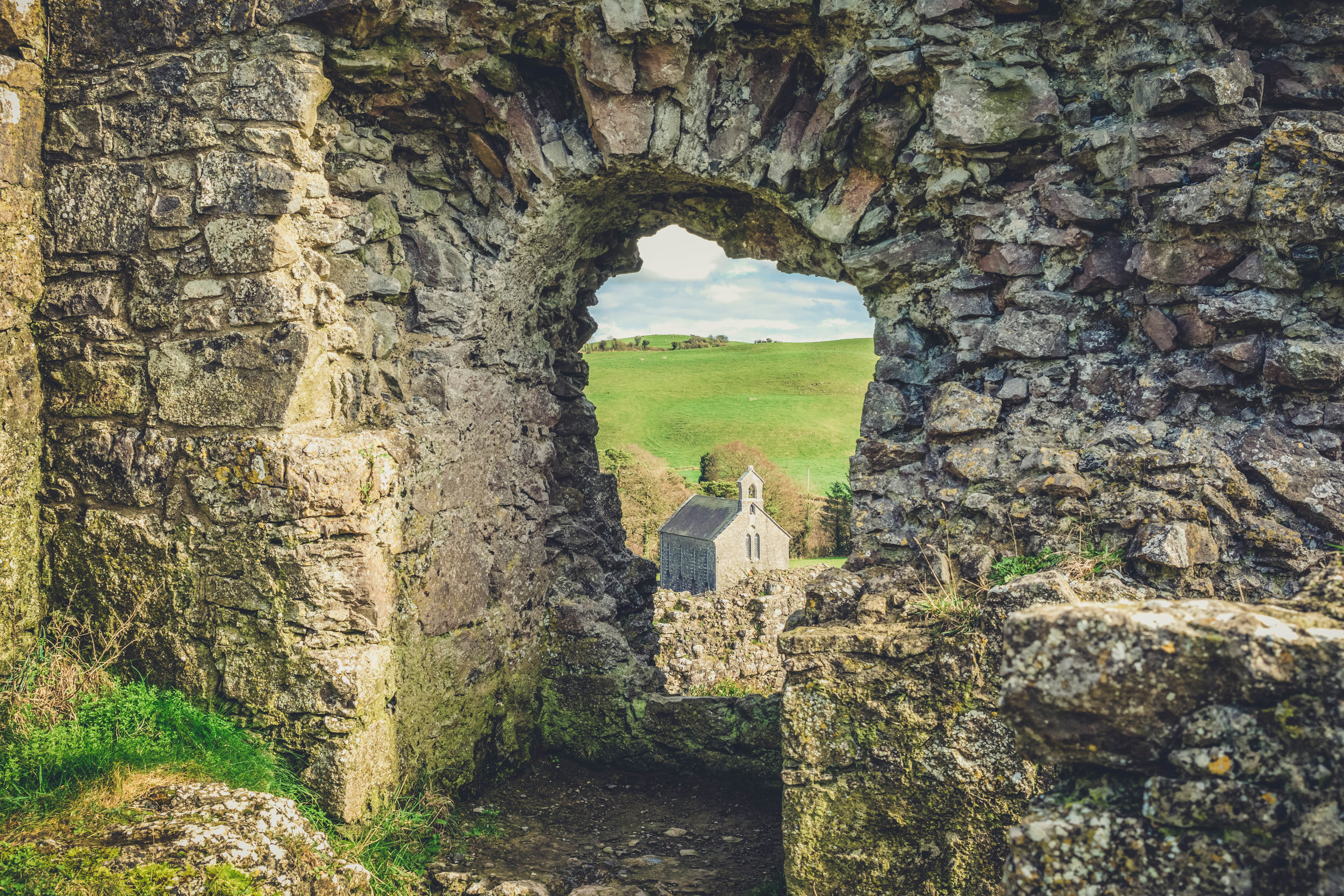 Ireland. Castle. Old castle. irish history. history. Rock of Dunamase. blue sky. rock. pathway. adventure. travel. irish counrty. green fields. castle archway. old church.jpg