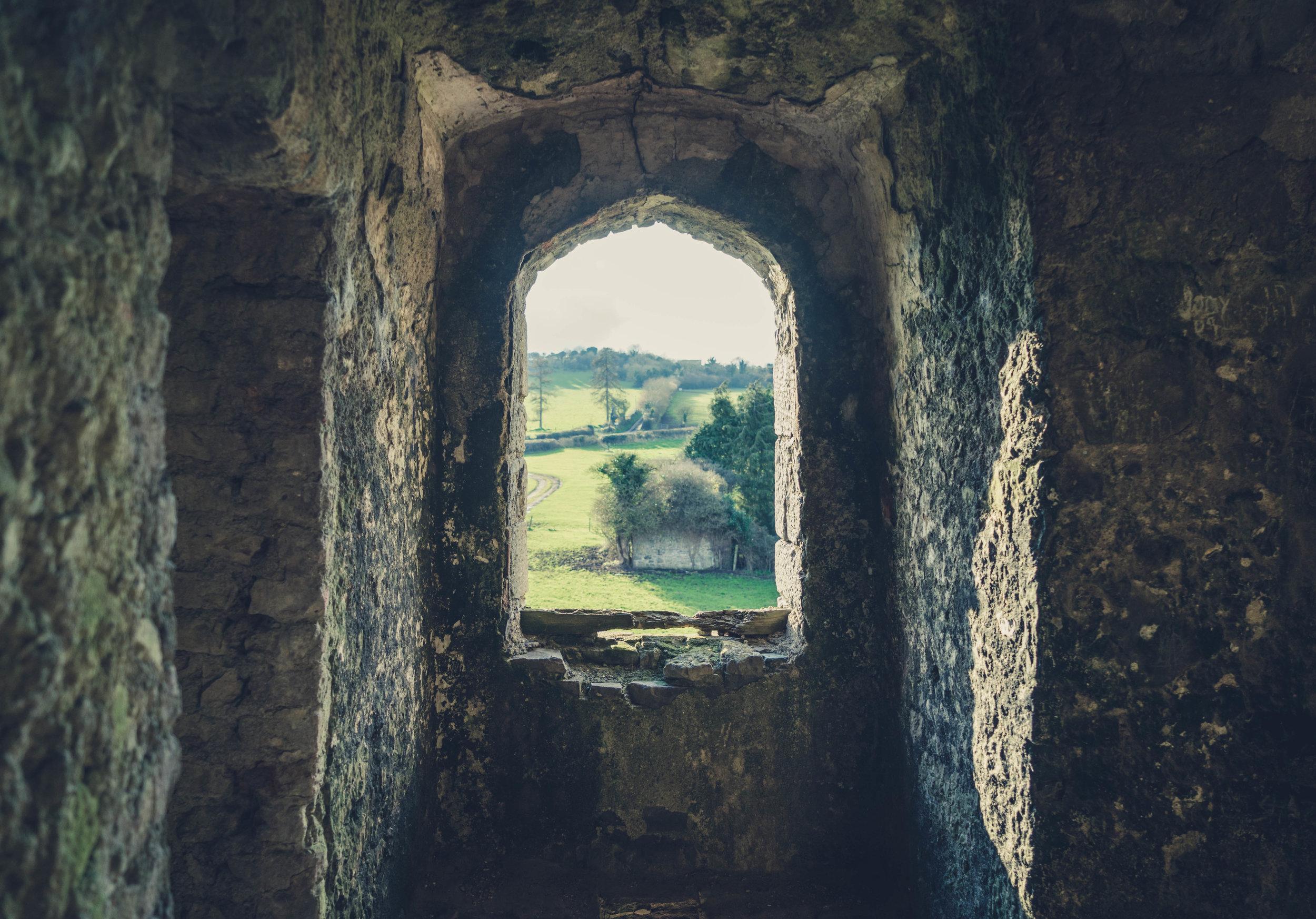 Ireland. Castle. Old castle. irish history. history. Rock of Dunamase. blue sky. rock. pathway. adventure. travel. irish counrty. Ballyadams castle.  window.jpg