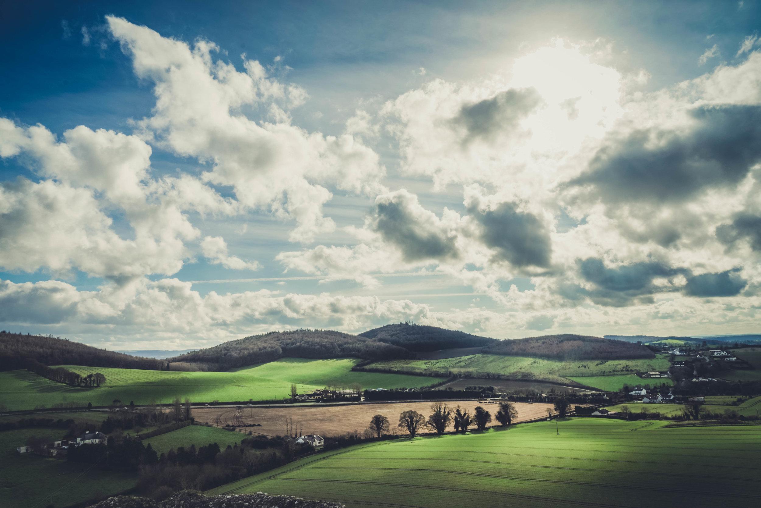 Ireland. Castle. Old castle. irish history. history. Rock of Dunamase. blue sky. rock. pathway. adventure. travel. irish counrty. green fields. sunlight.jpg