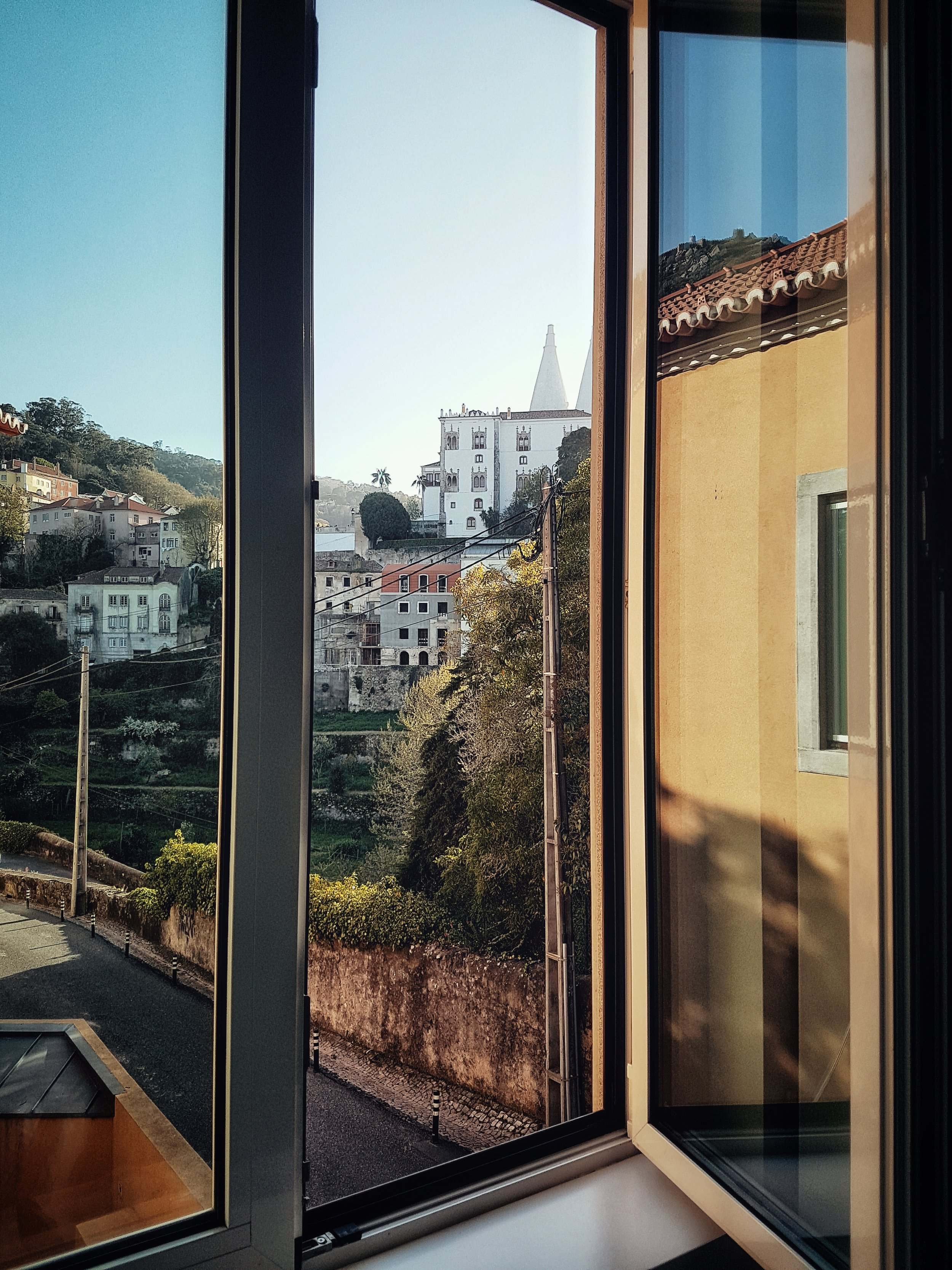 Portugal. Travel. Sintra. Sunshine. Hotel. History. view. room with a view. pena palace.  palace. town. old town. through the window.jpeg