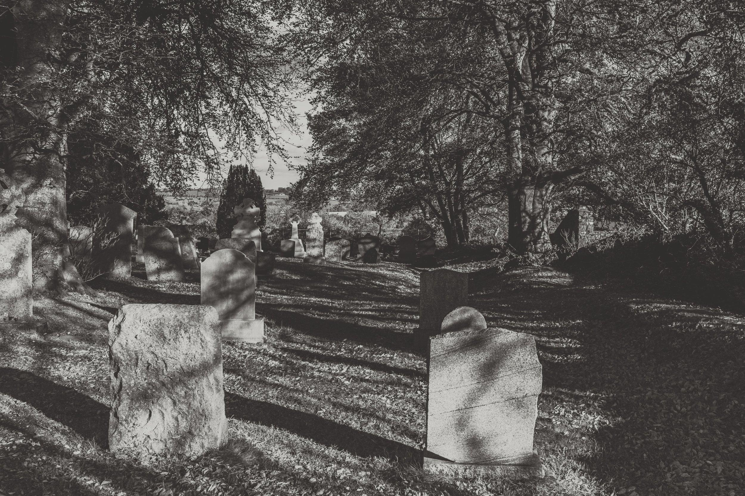 Hill of tara. ireland. history. irish. golden light. travel. blog. autumn. colour. celtic. gaelic. grave. head stones.jpg
