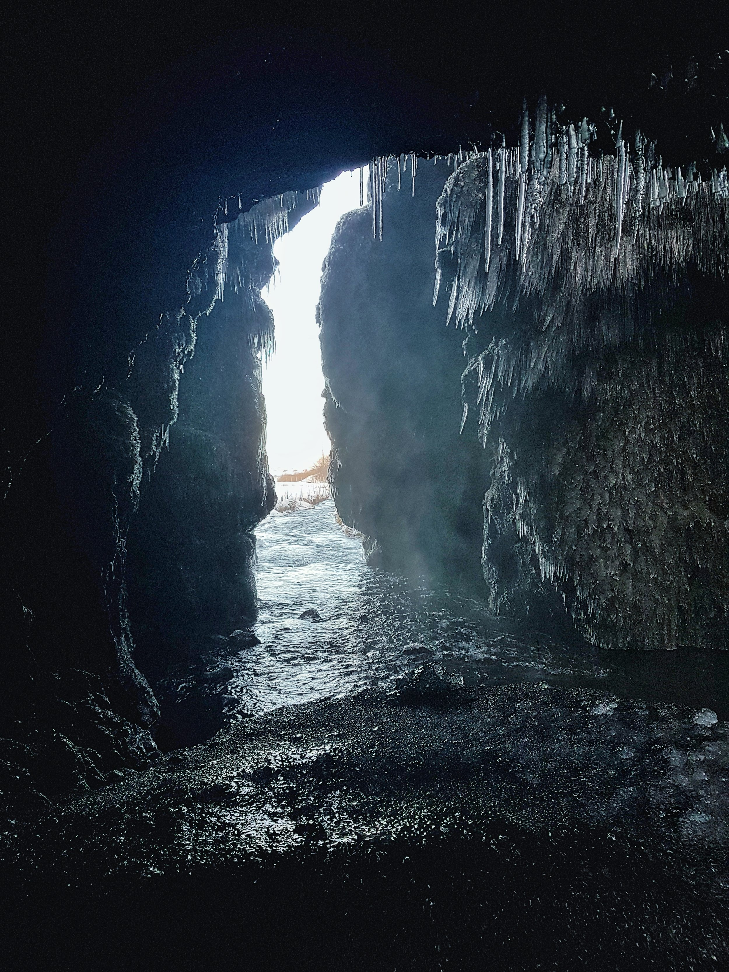 Iceland. snow. travel. adventure. photography. trip. epic landscape. snow. cold. freezing. sunrise. cave mouth.jpg