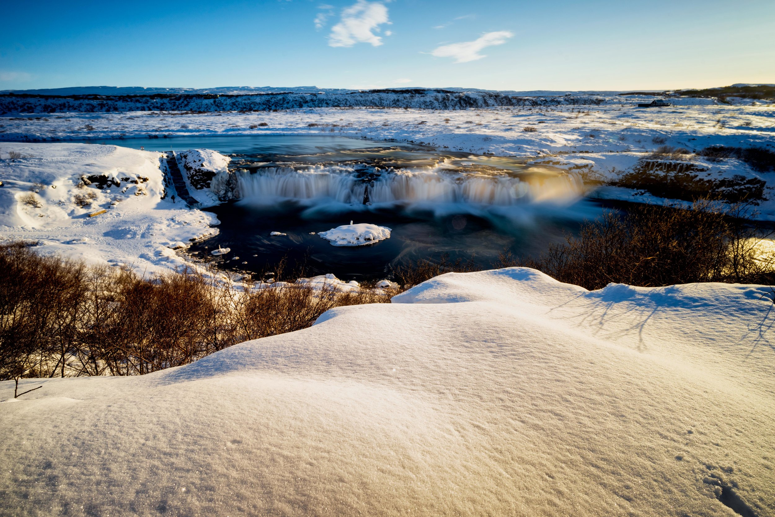 Iceland. snow. travel. adventure. photography. trip. epic landscape. snow. cold. freezing. sunrise. looking over faxifoss.jpg