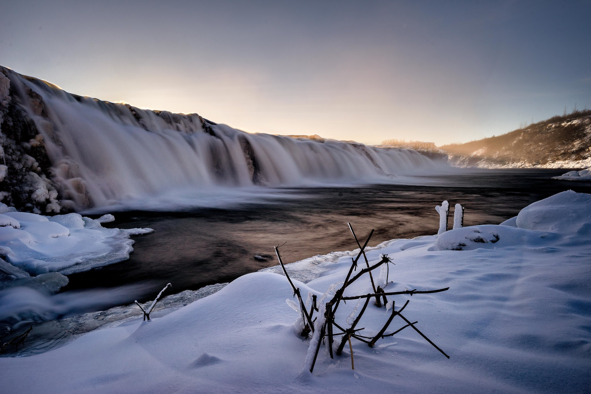 Iceland. snow. travel. adventure. photography. trip. epic landscape. snow. cold. freezing. sunrise. faxifoss. long exposure.jpg