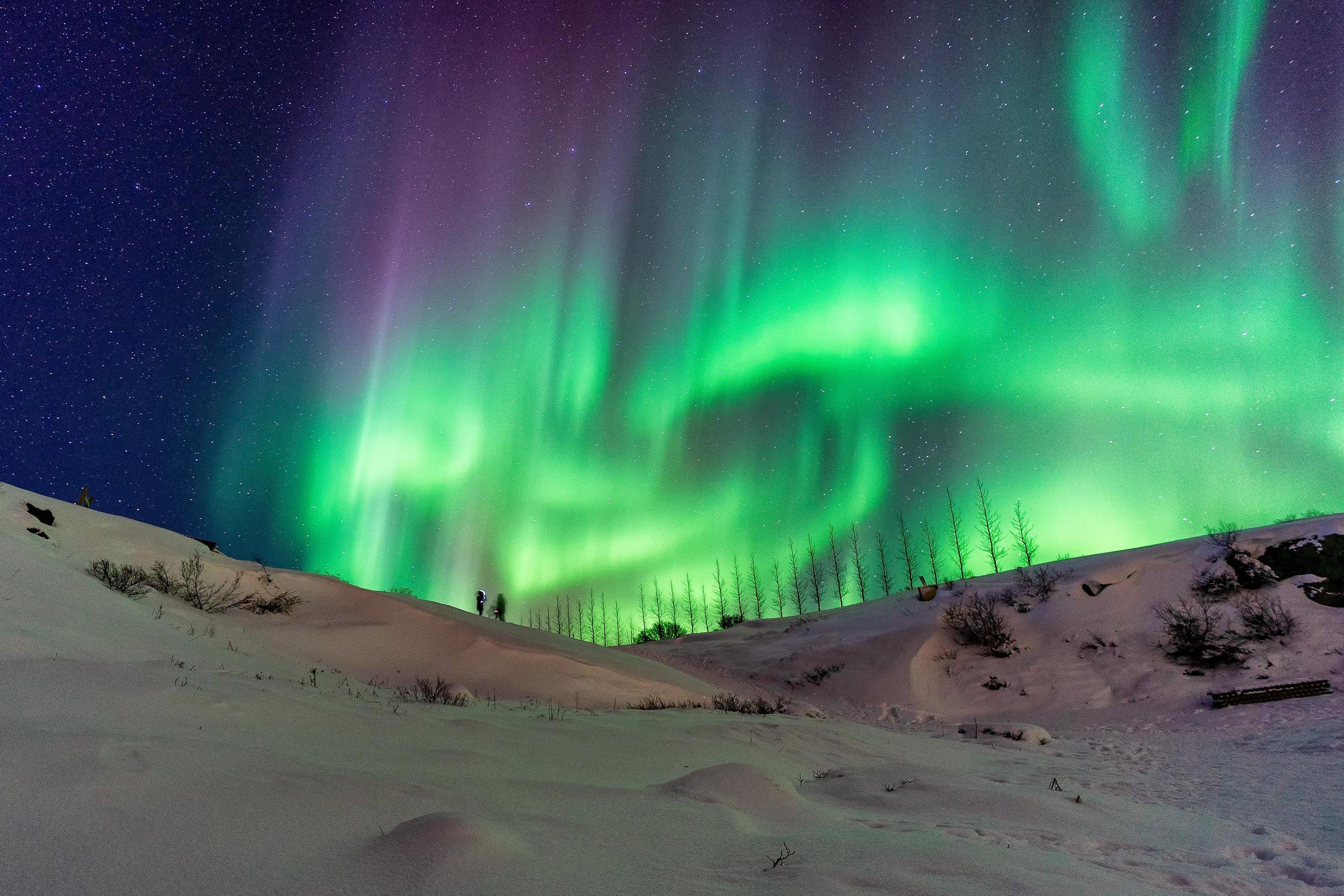 Iceland. snow. travel. adventure. photography. trip. epic landscape. snow. cold. freezing. sunrise. nothern lights. couple underlights.jpg
