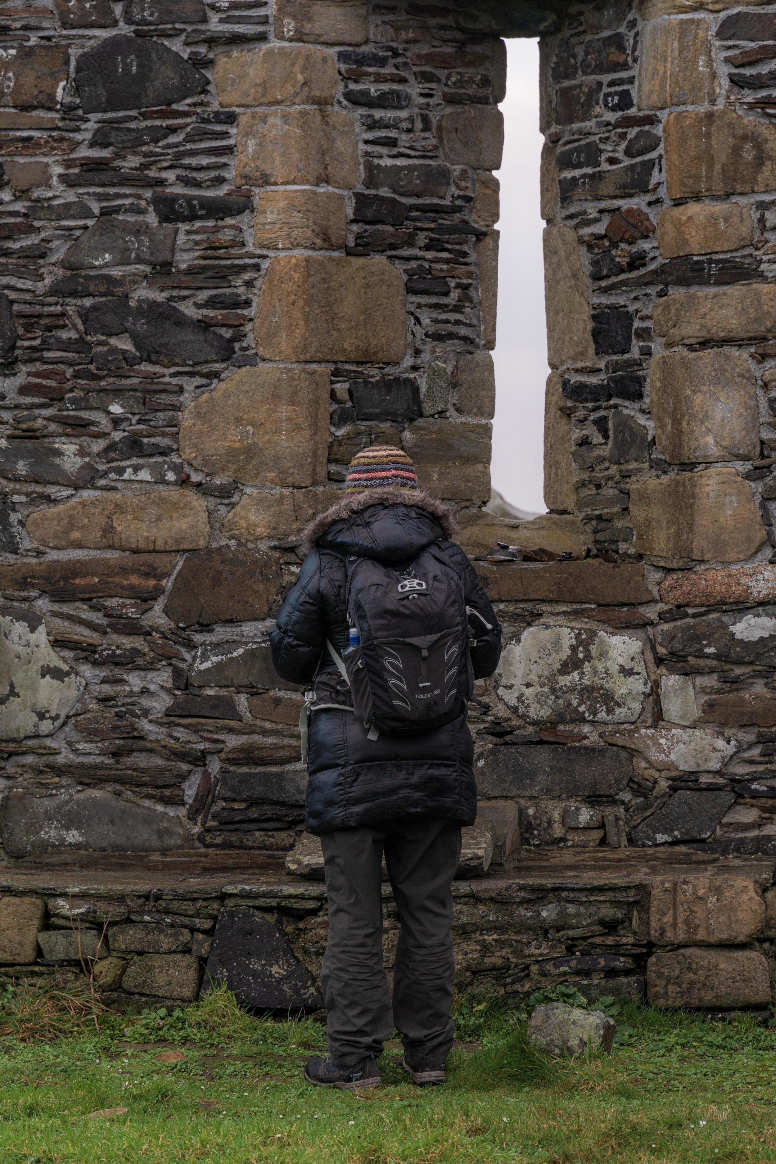 girl at old church ruin in ireland