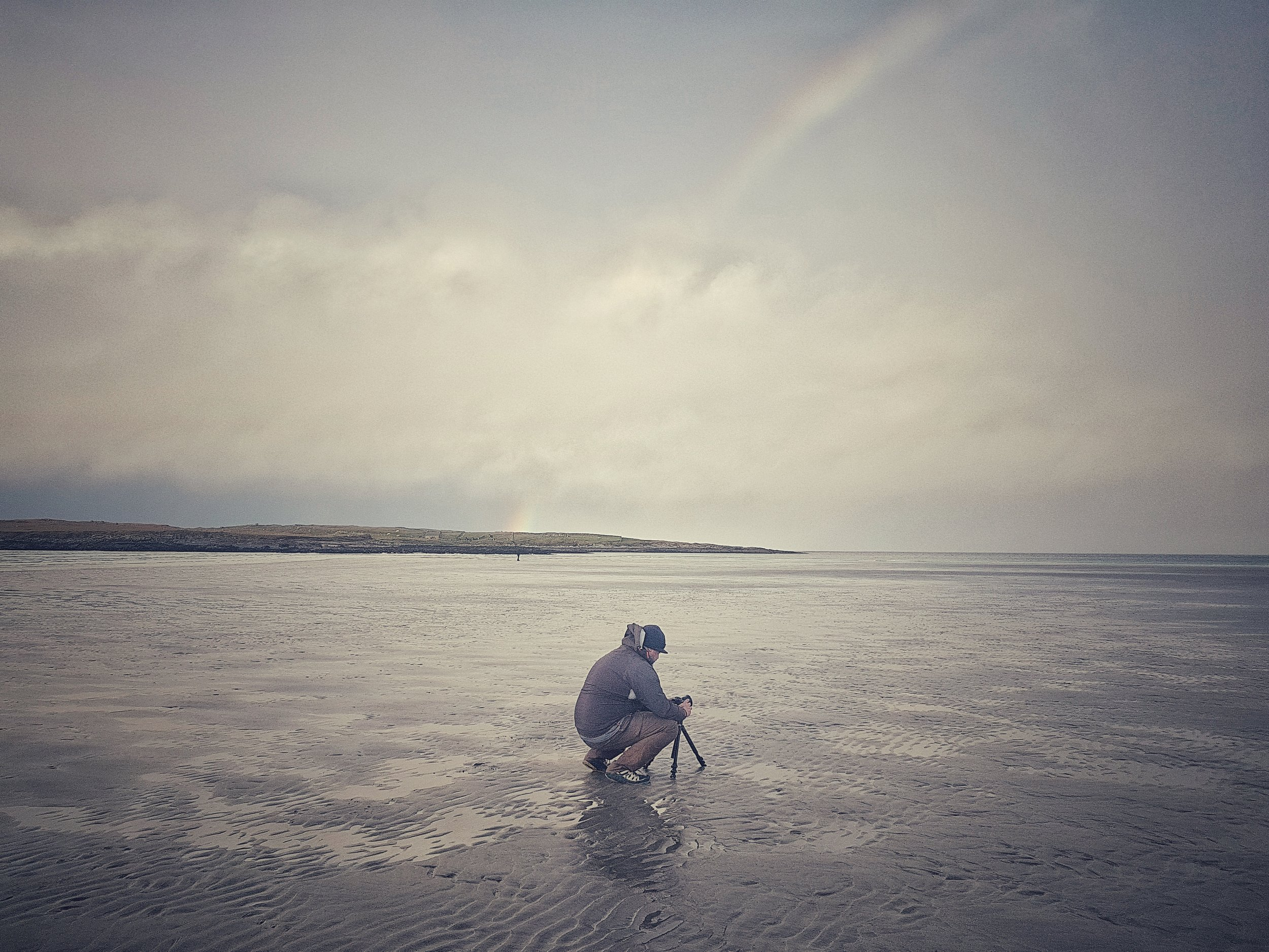 photographer taking images of rainbows