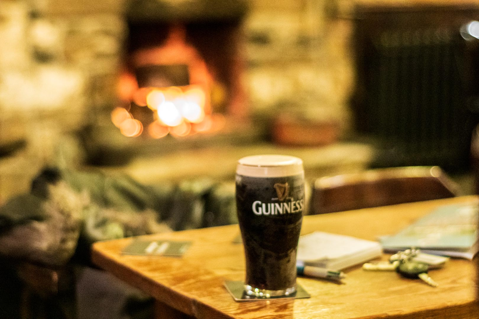 guinness by the fire in an irish pub