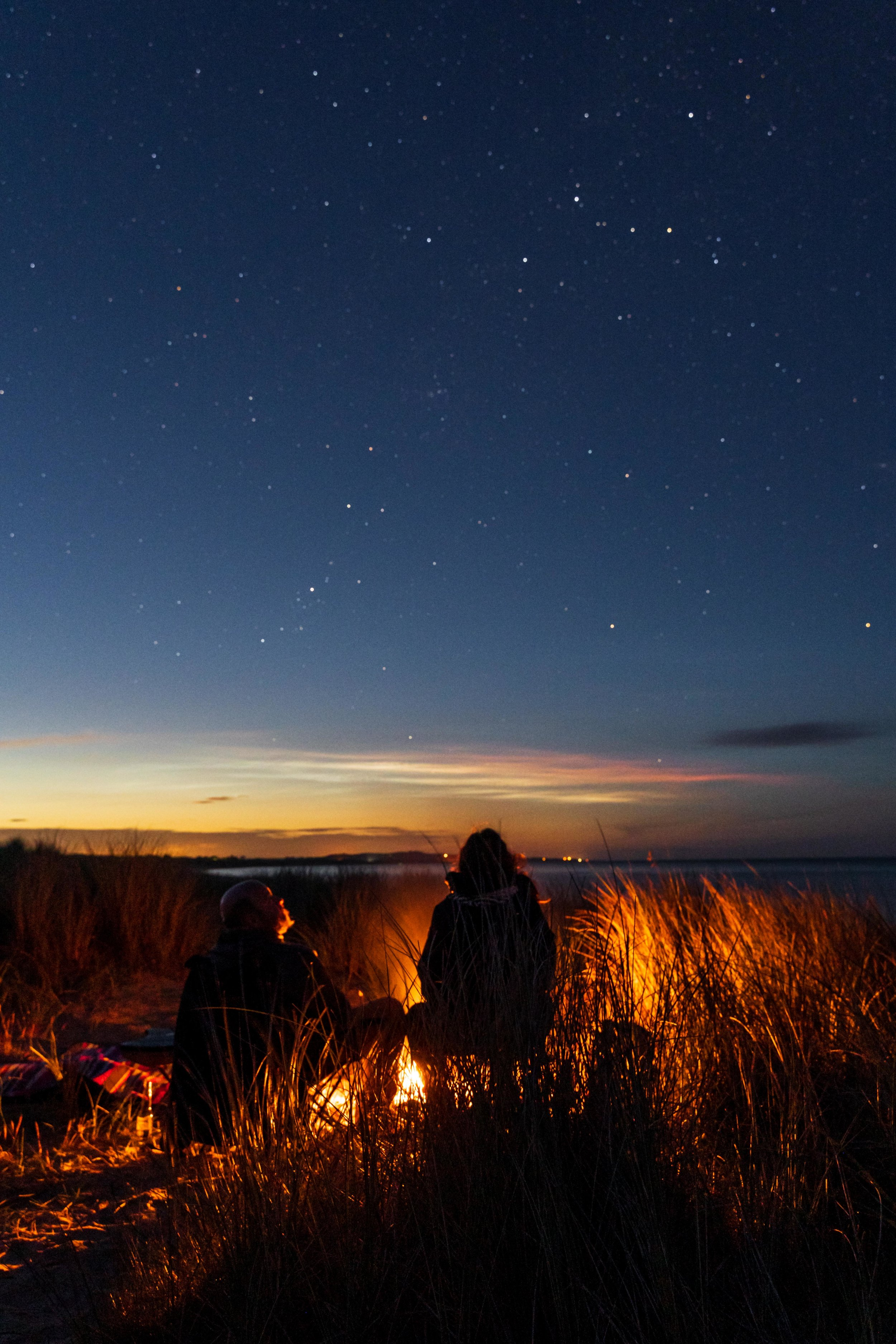 The Raven forest and beach wexford ireland campfire couple under stars.jpg
