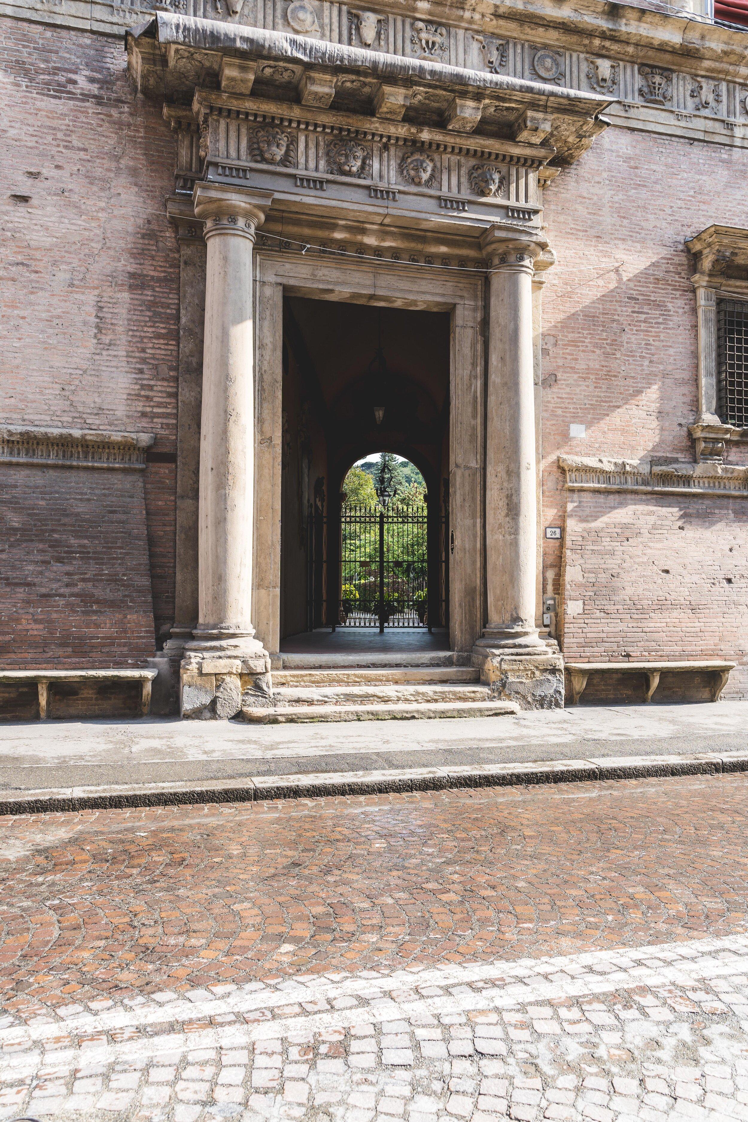 street photography in bologna big door.jpg