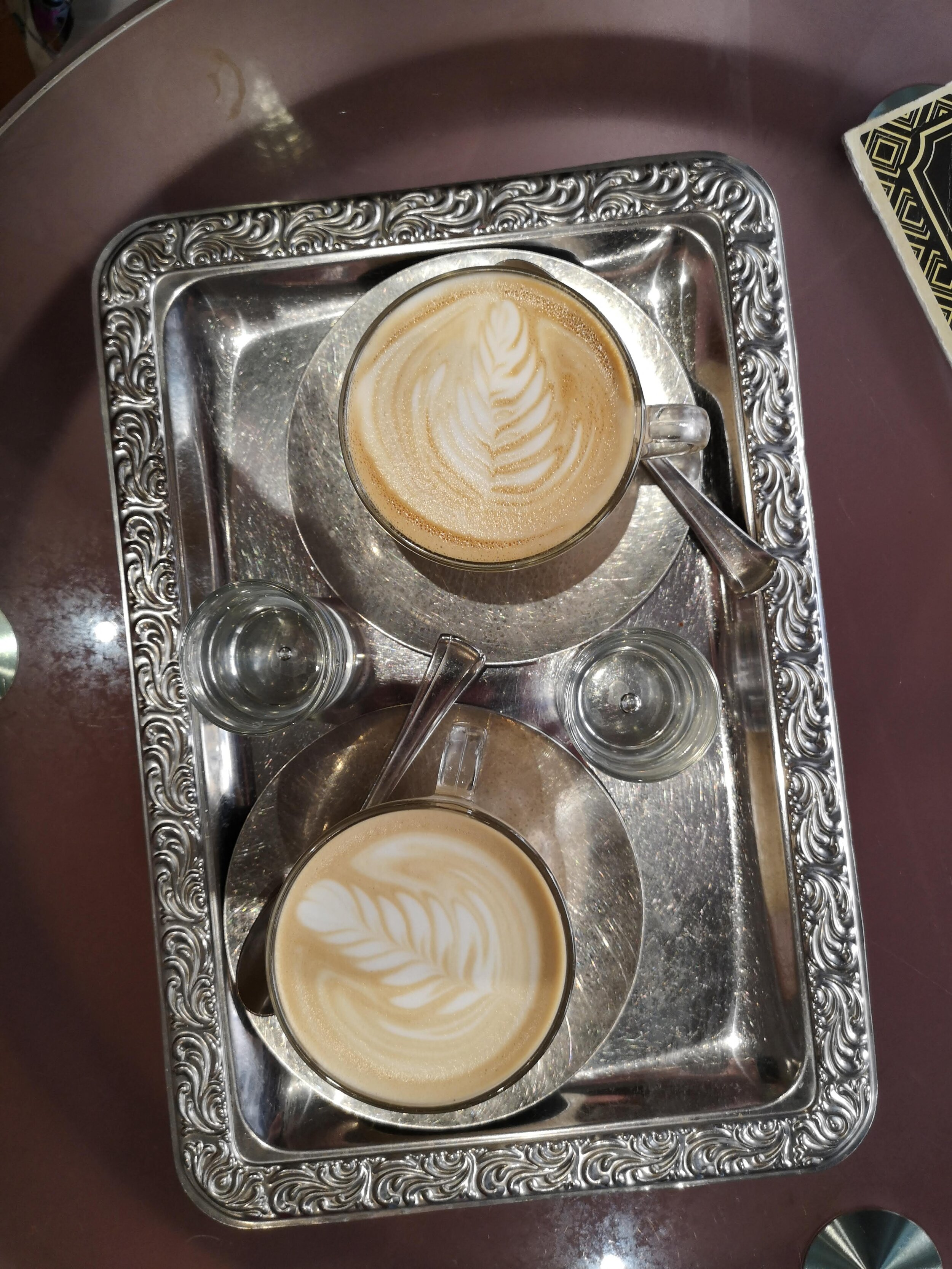 two lattes on silver tray.jpg