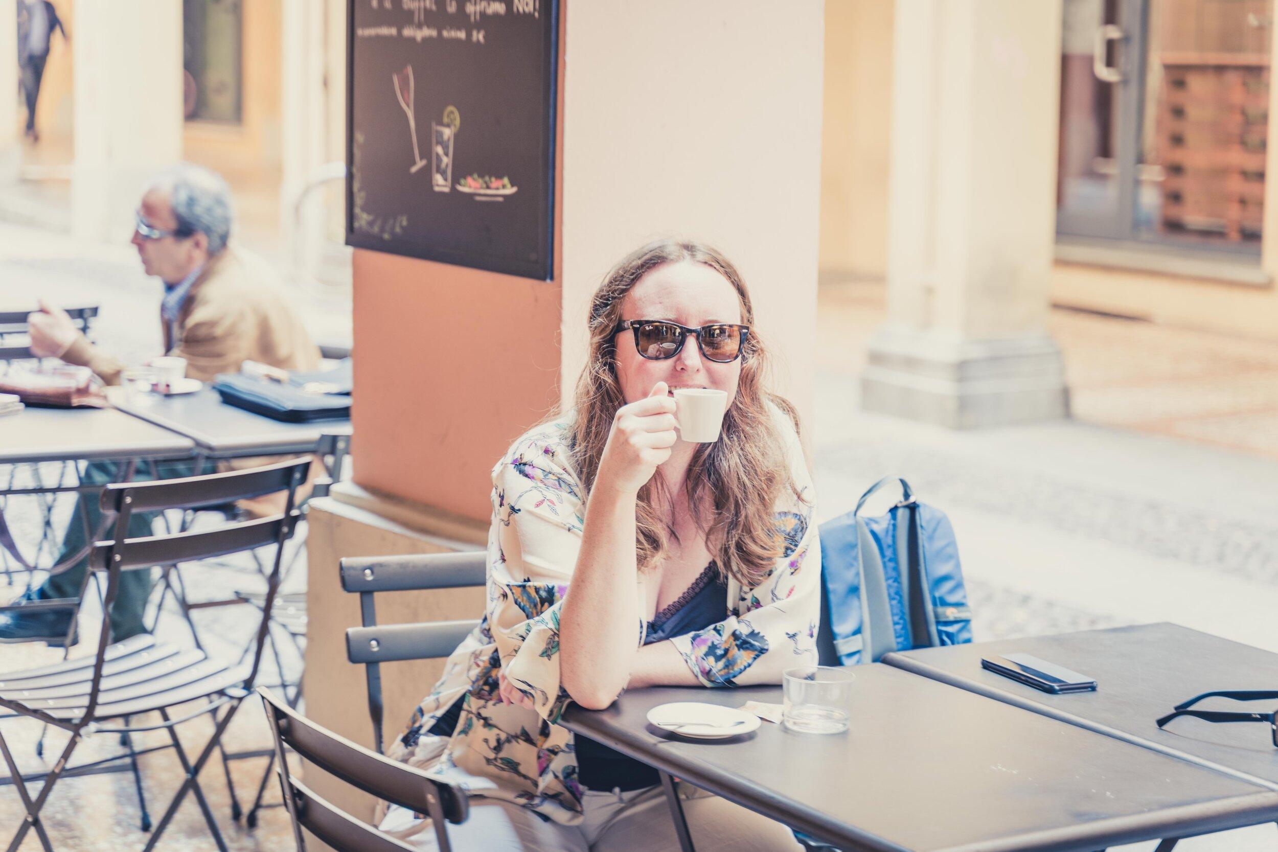 girl enjoys italian coffee .jpg