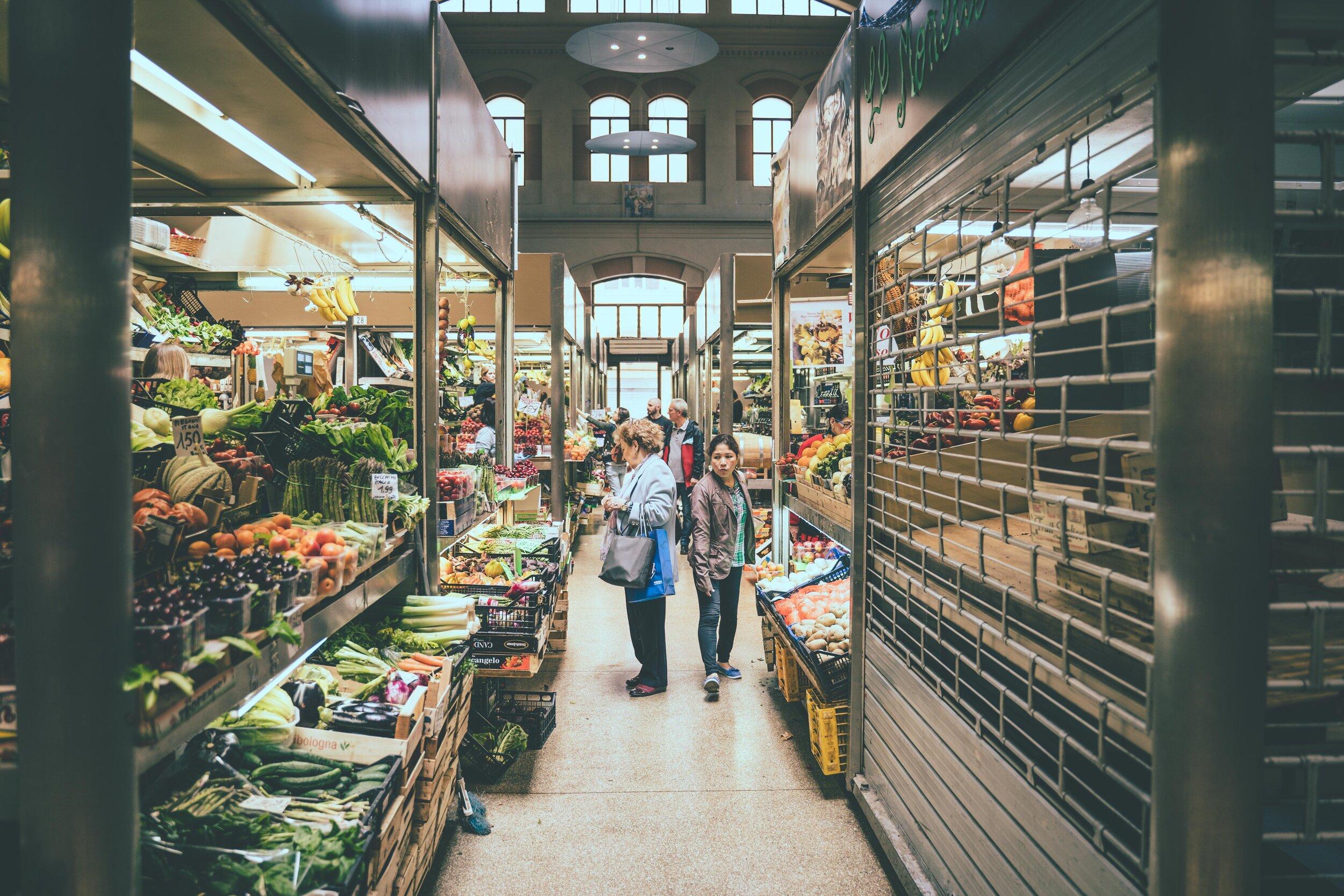 customers shopping in fruit and veg market].jpg