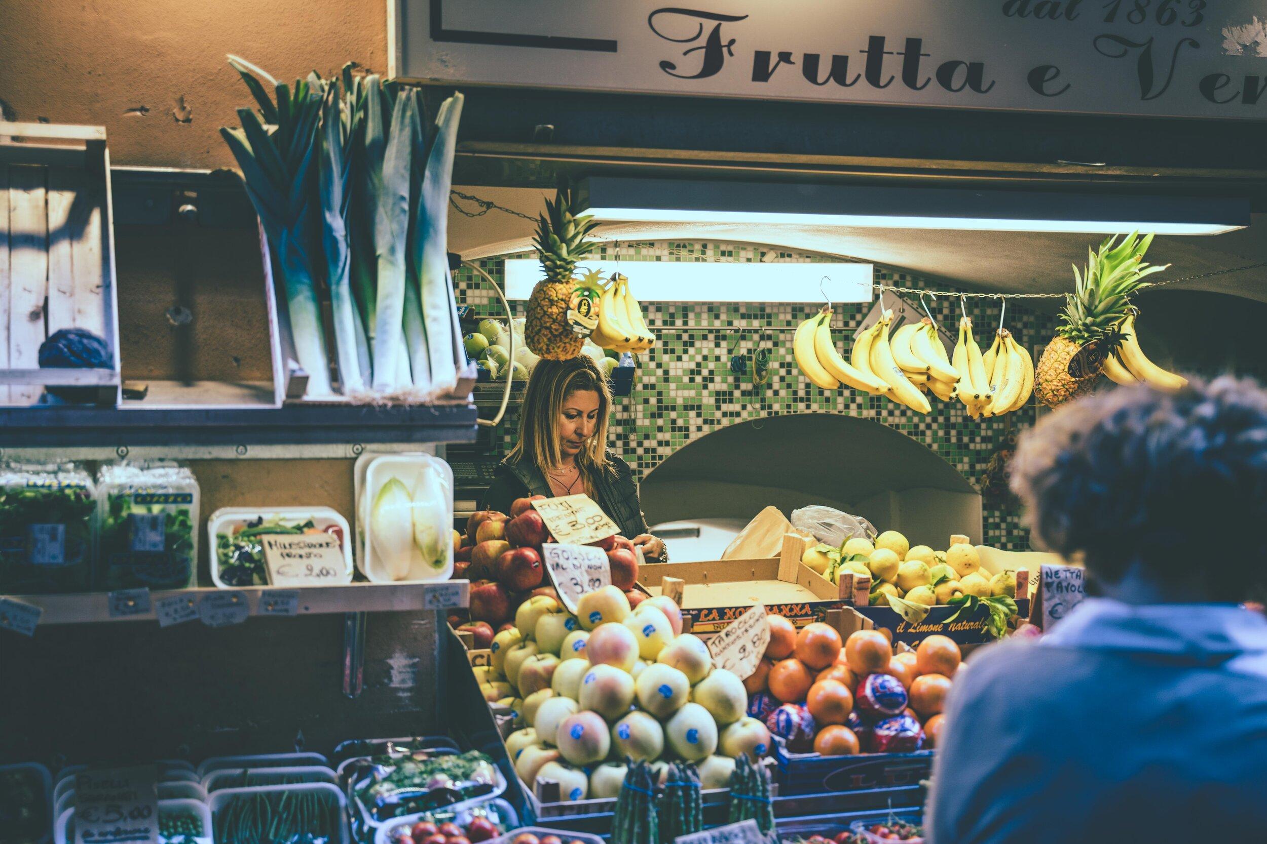 lady in market selling fruit.jpg