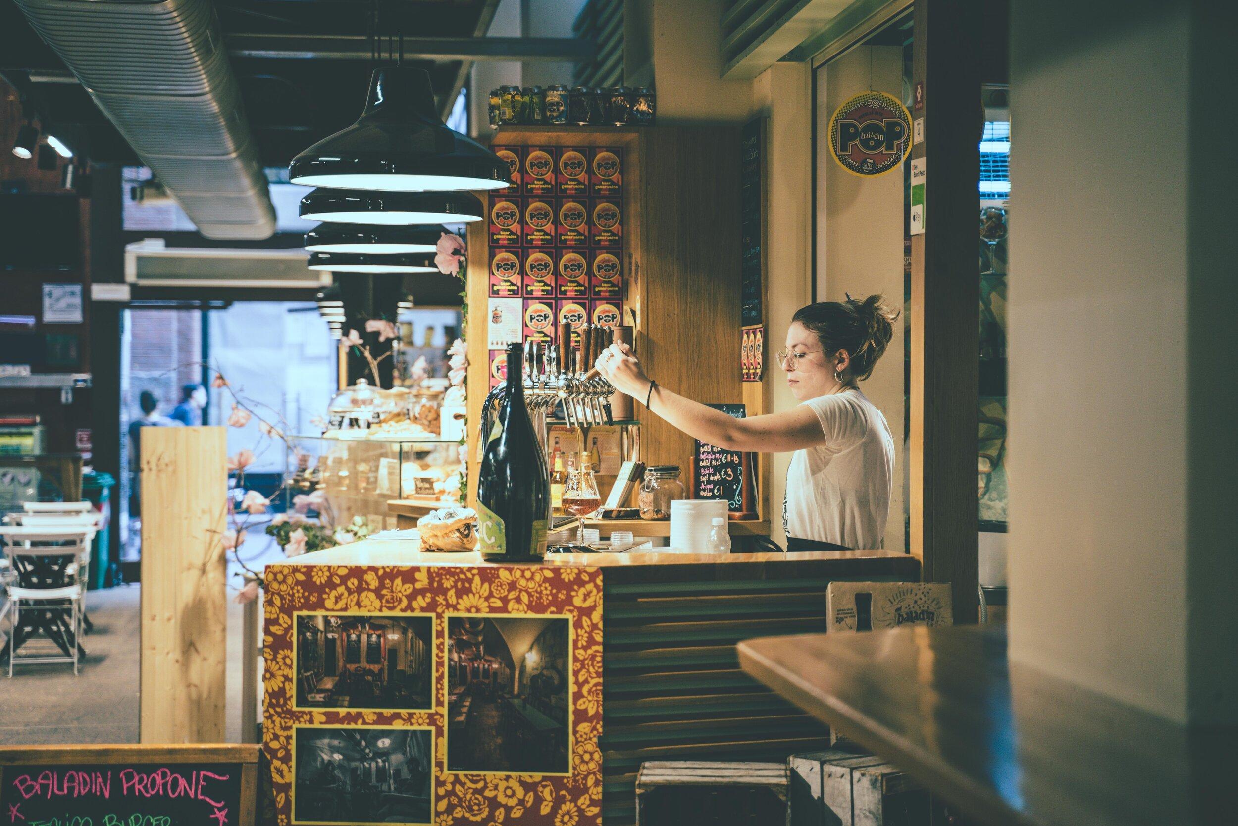 lady in market pulling beer on tap.jpg