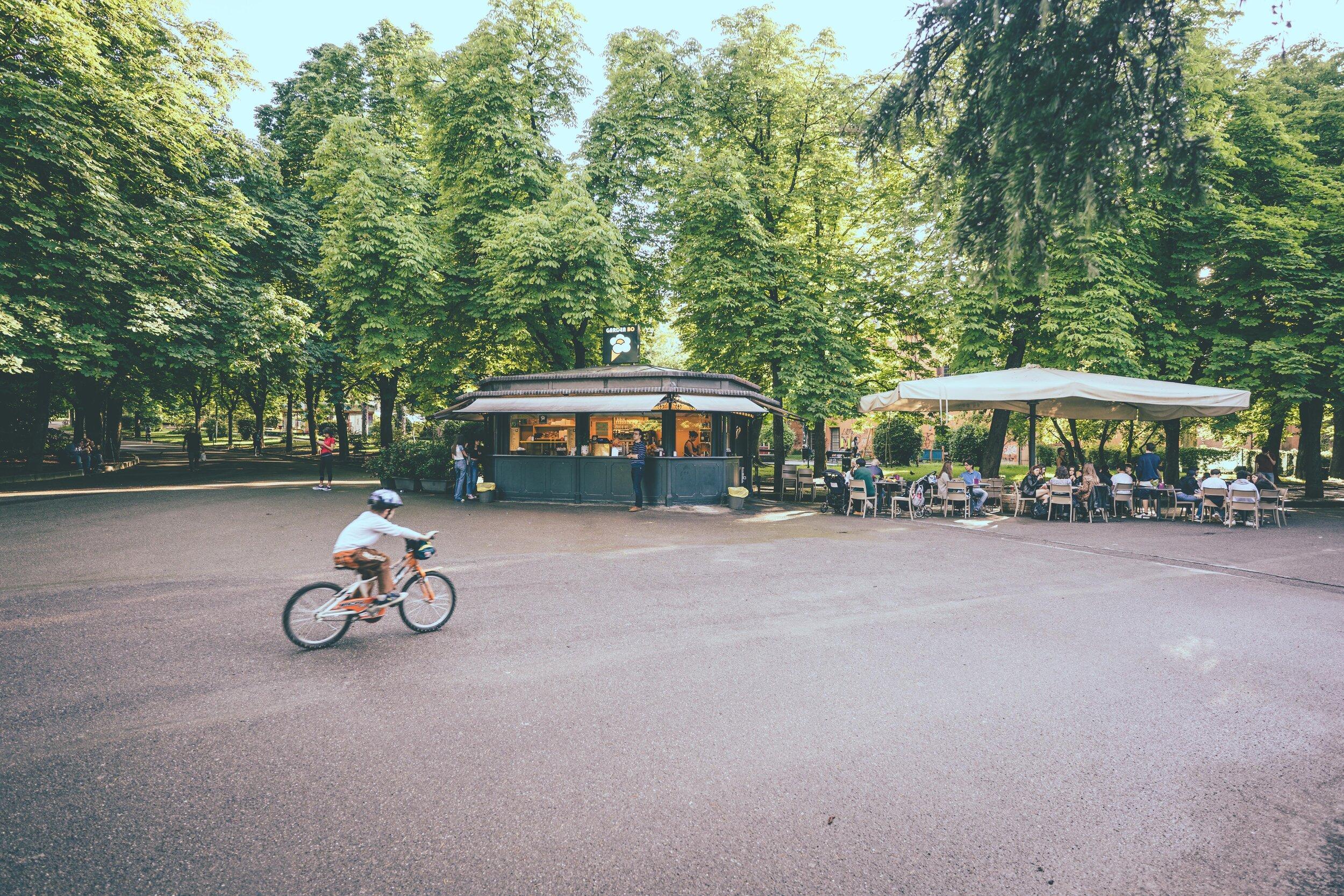 child on bike in city park Giardini Margherita.jpg