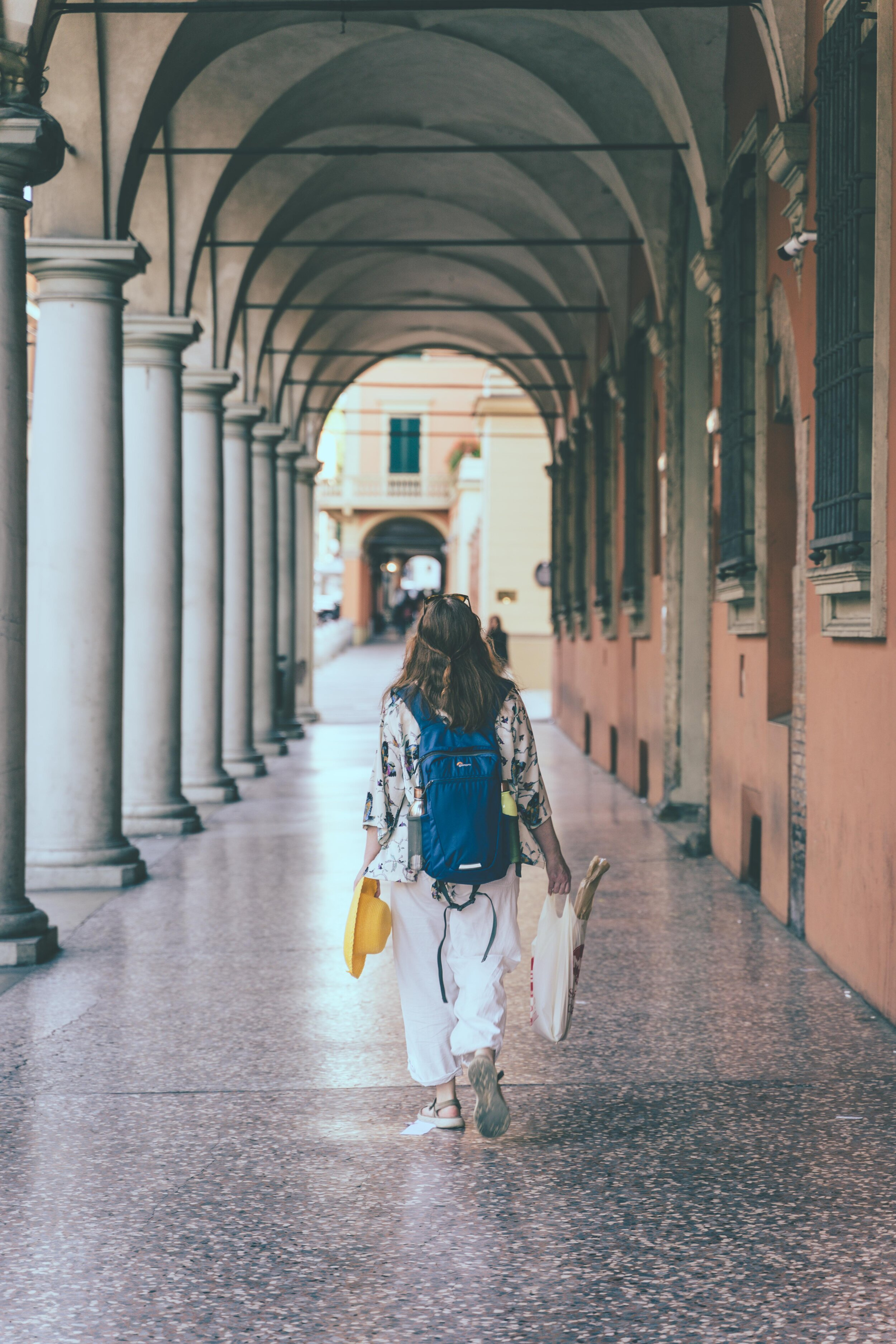 girl with shopping walking though portico.jpg
