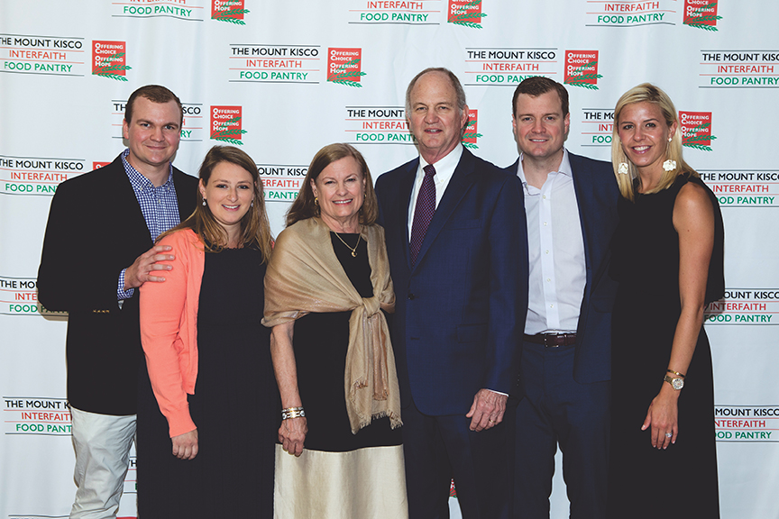 Left to right, Robbie and Jamie Scott, Honoree Harriette Scott and husband Louis, Alex and Lauren Scott.