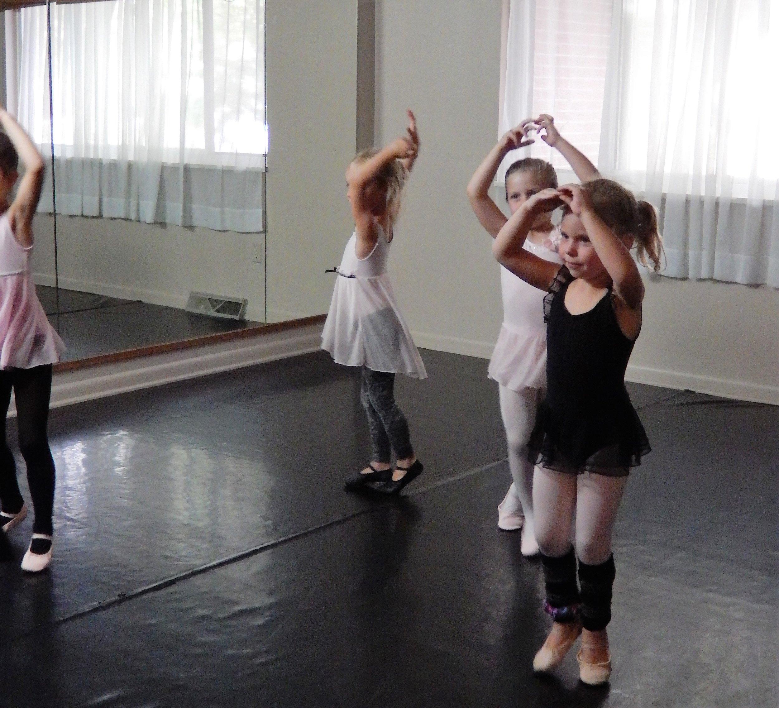 Petite Ballerinas Dancing in a circle