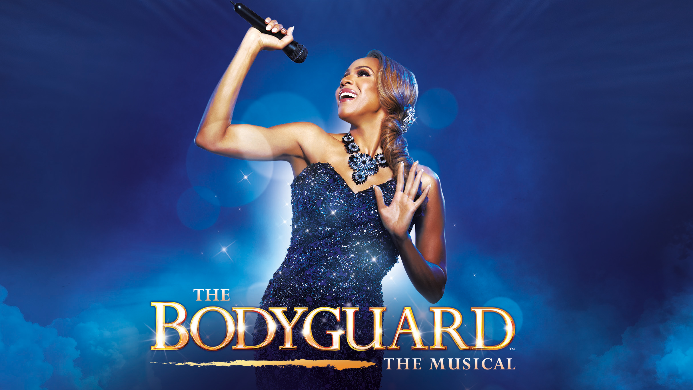 "Image description: Rachel Marron (Deborah Cox) smiles and belts into a microphone in her raised right hand. Seen from the waist up, she wears a strapless dress of shimmering beaded navy blue against a bright blue background. At the bottom, gold text reads: ""The Bodyguard"" The Musical."
