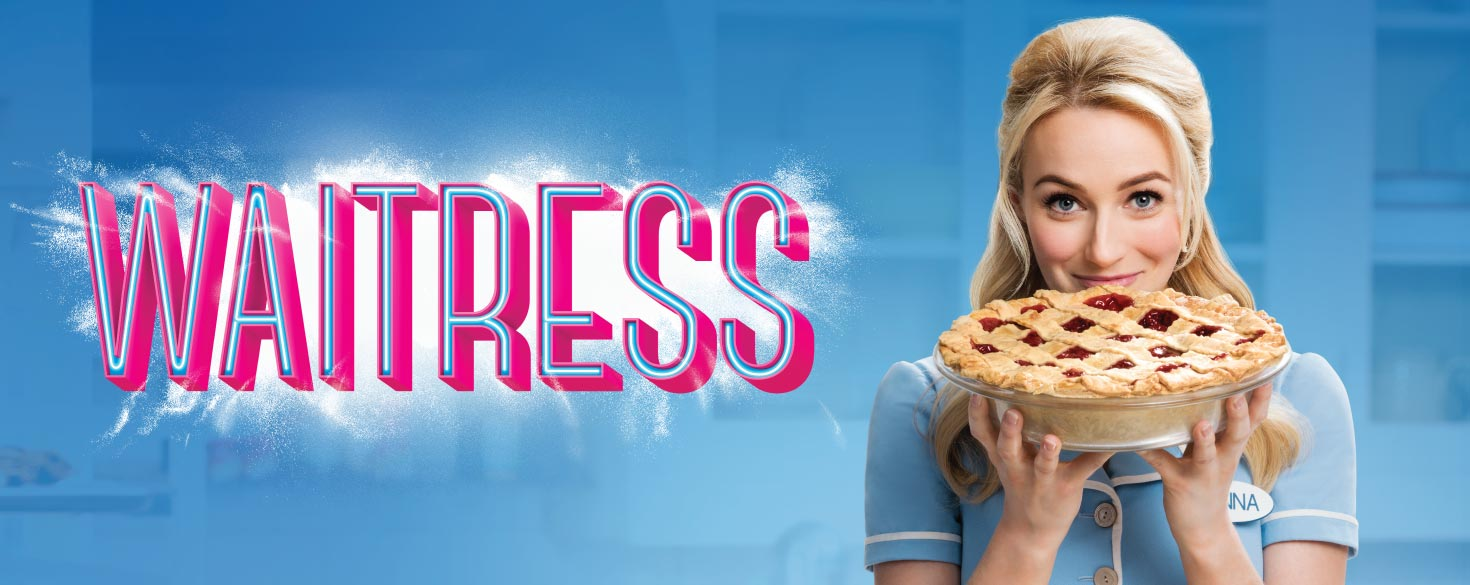 "Image description: Sky blue background. At left, pink text over a dusting of white flour reads ""Waitress"". At right, a close up photo of a waitress smiling and holding up a cherry pie in her hands."