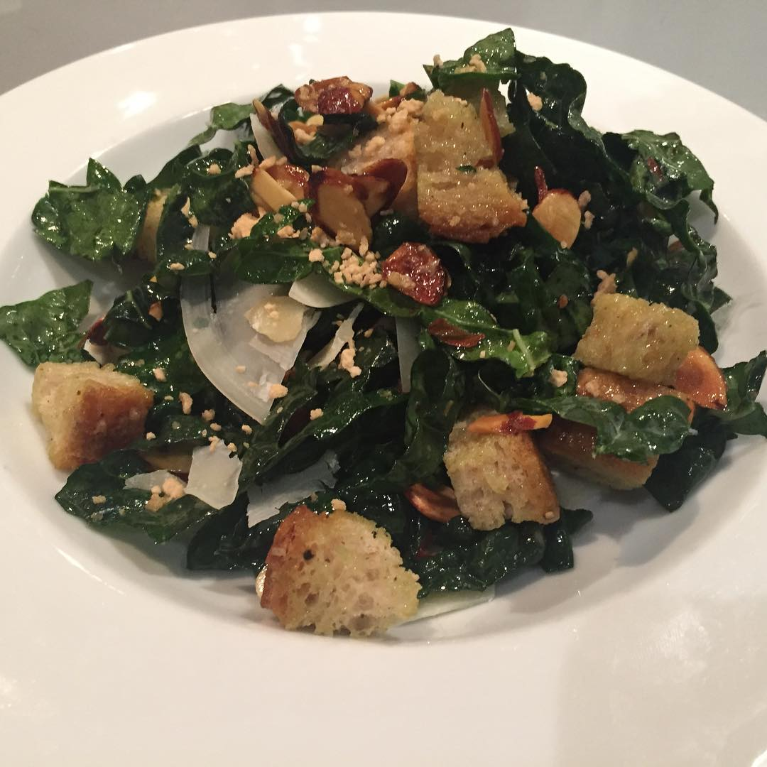 First Course: Maple Kale Salad with Toasted Almonds, Parmigiano-Reggiano and Rustic Croutons, found on page 107 in   The Vermont Non-GMO Cookbook  .