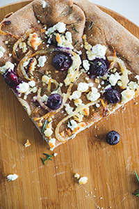 Blueberry Goat Cheese Pizza with Caramelized Onions and Rosemary/Photo by Brent Harrewyn
