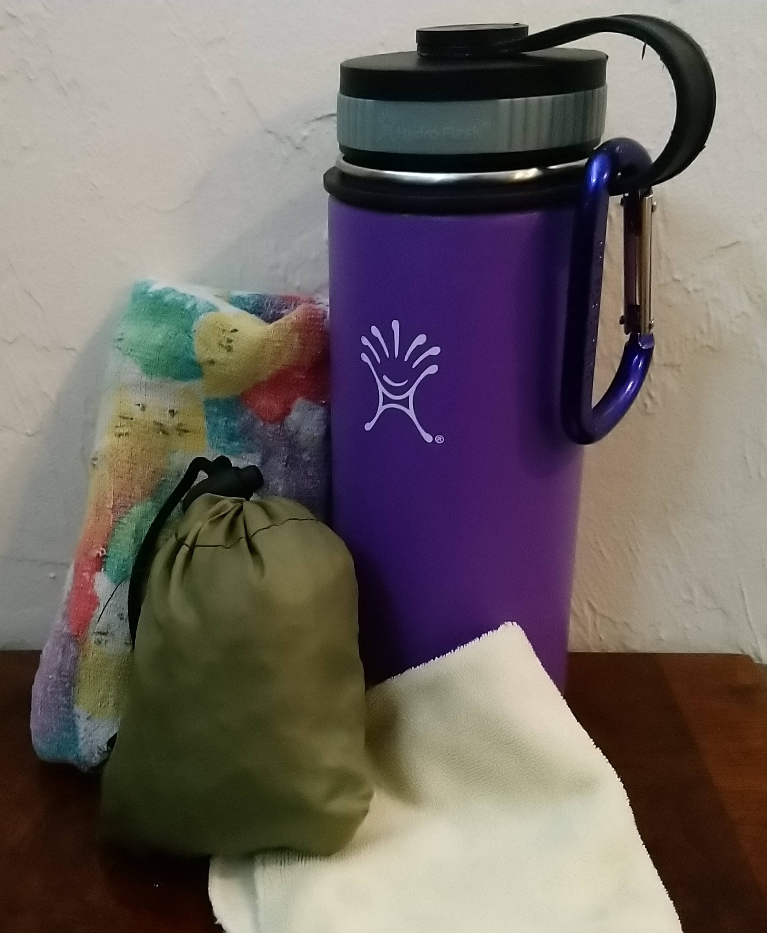 My most used travel items - water bottle, ChicoBag, napkin, and small multi-purpose cloth