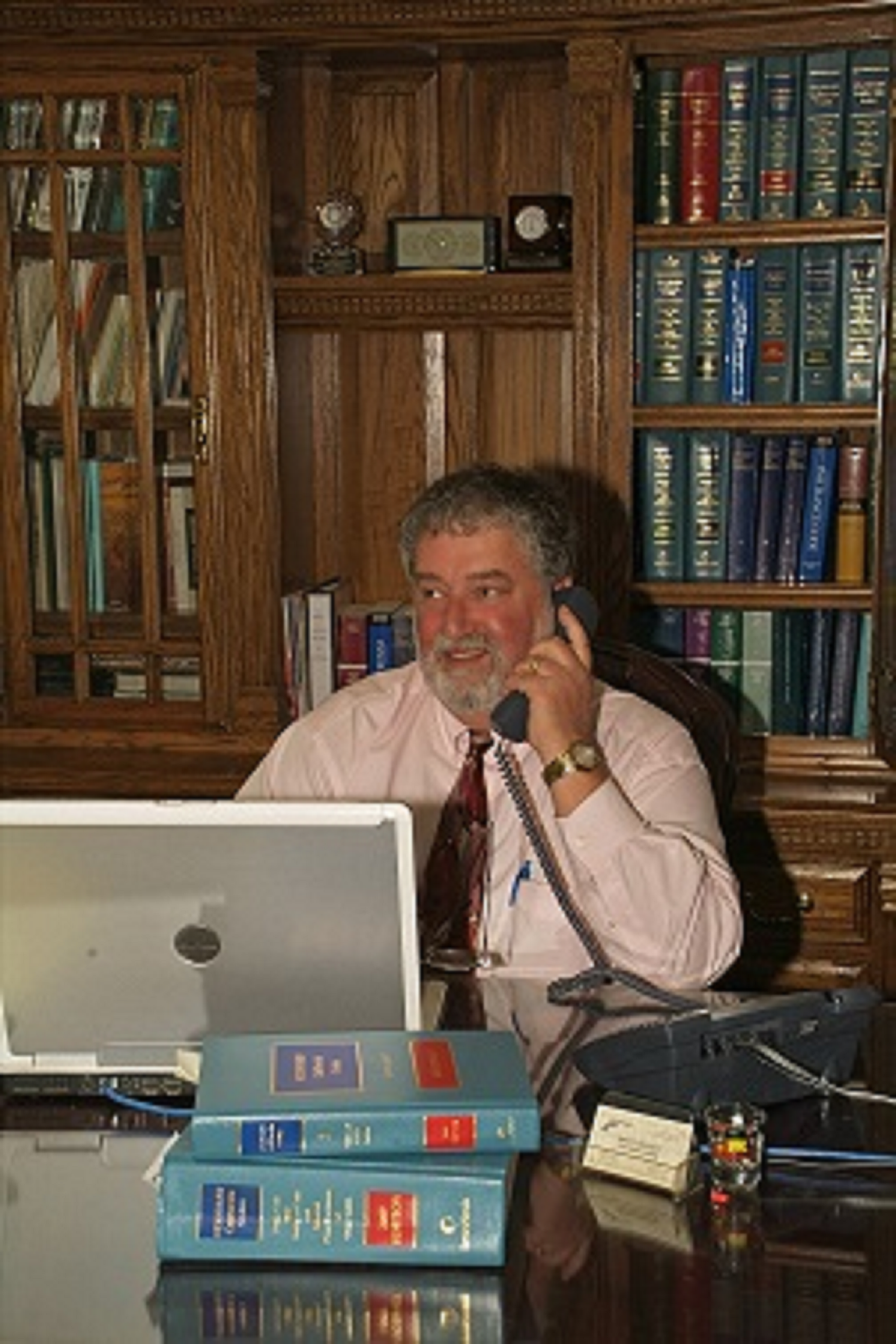 Bruce on phone at desk png extra large.png