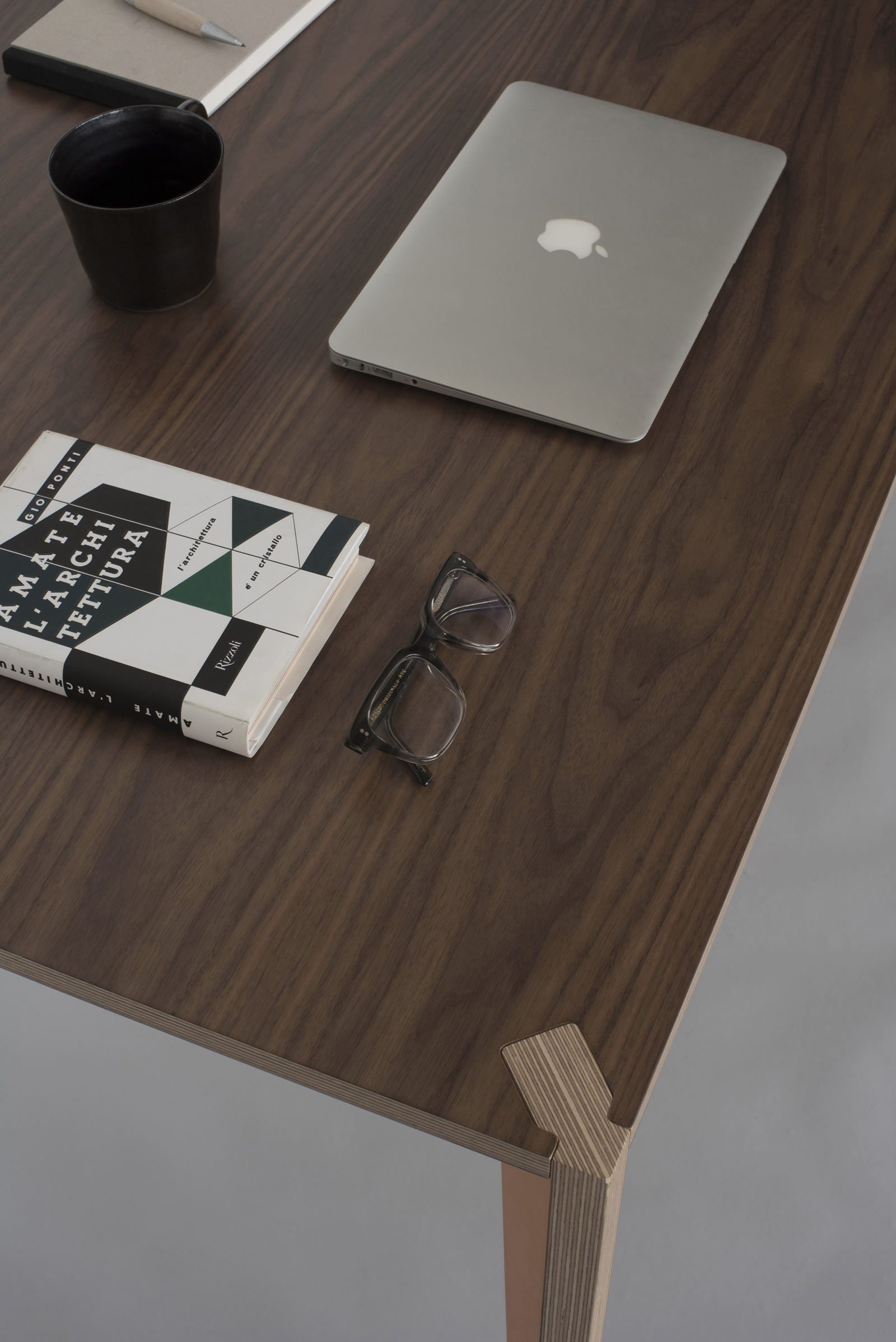 Walnut top and contrasting joiner in our MiMi table.